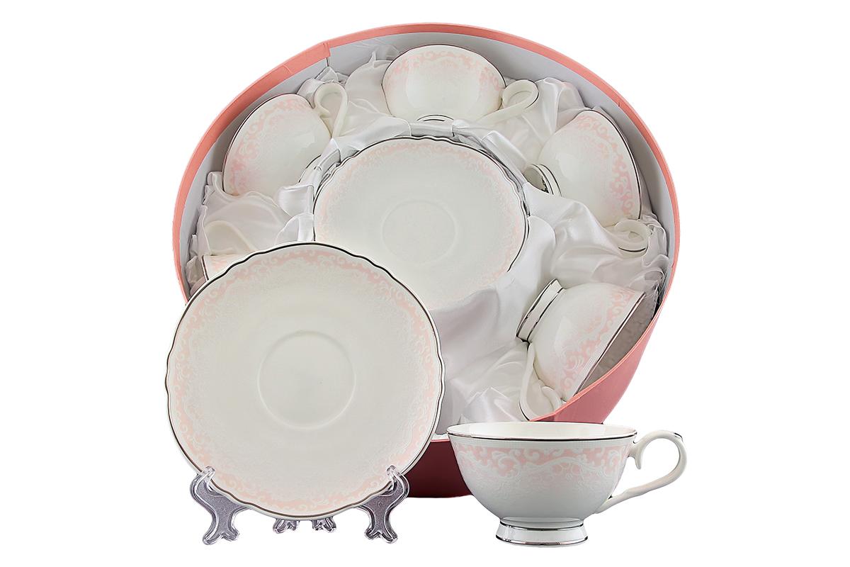 Набор чайный Elan Gallery Розовый шик, 12 предметов530029Чайный набор Elan Gallery Розовый шик состоит из 6 чашек и 6 блюдец. Изделия, выполненные из высококачественной керамики, оформлены изысканным изображением цветочных узоров. Такой набор прекрасно подойдет как для повседневного использования, так и для праздников. Чайный набор Elan Gallery Розовый шик - это не только яркий и полезный подарок для родных и близких, это также великолепное дизайнерское решение для вашей кухни или столовой. Не рекомендуется применять абразивные моющие средства. Не использовать в микроволновой печи. Объем чашки: 250 мл. Диаметр чашки (по верхнему краю): 10,8 см. Высота чашки: 6 см. Диаметр блюдца (по верхнему краю): 15,8 см. Высота блюдца: 2 см.