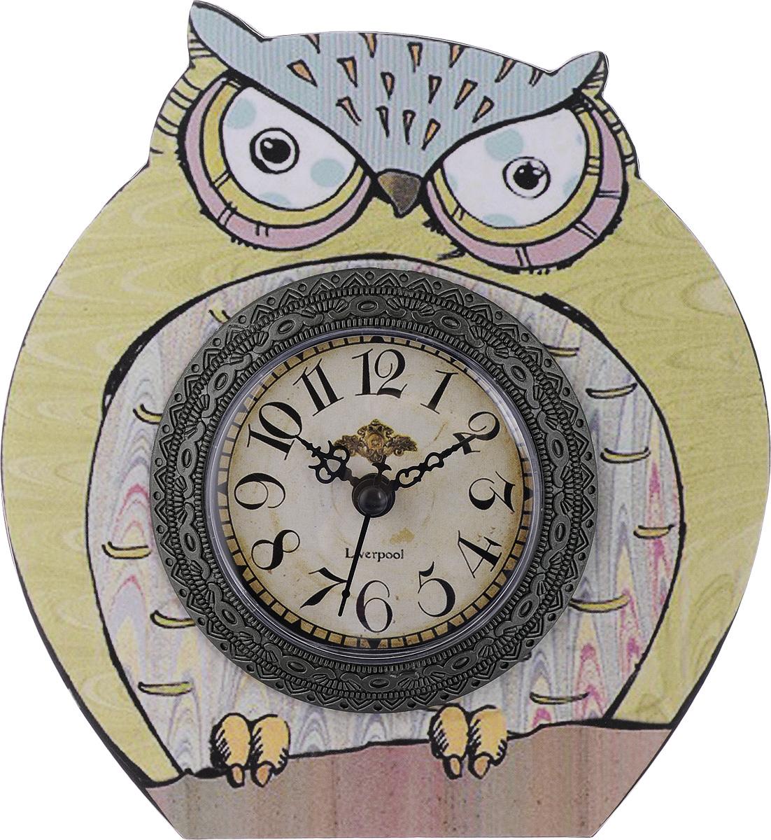 Часы настольные Феникс-Презент Мудрый филин, 17 х 16 см40736Настольные часы Феникс-Презент Мудрый филин своим эксклюзивным дизайном подчеркнут оригинальность интерьера вашего дома. Часы выполнены из МДФ в виде филина. МДФ (мелкодисперсные фракции) представляет собой плиту из запрессованной вакуумным способом деревянной пыли и является наиболее экологически чистым материалом среди себе подобных. Часы имеют три стрелки - секундную, часовую и минутную. Настольные часы Феникс-Презент Мудрый филин подходят для кухни, гостиной, прихожей или дачи, а также могут стать отличным подарком для друзей и близких. ВНИМАНИЕ!!! Часы работают от сменной батареи типа АА 1,5V (в комплект не входит).