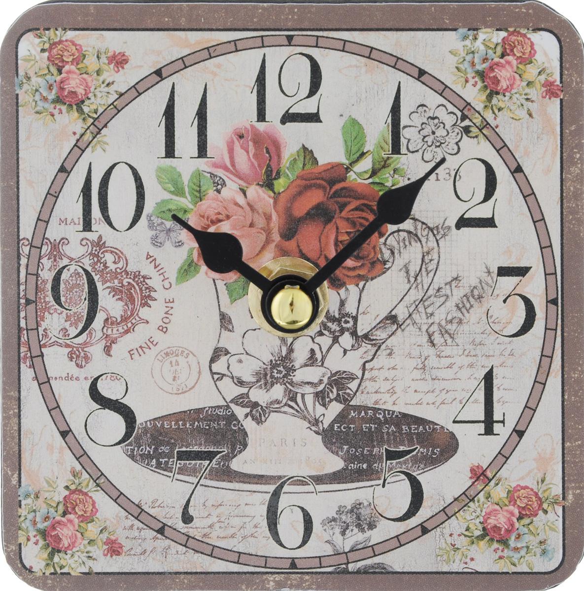 Часы настольные Феникс-Презент Ваза с цветами, 10 х 10 см40727Настольные часы квадратной формы Феникс-Презент Ваза с цветами своим эксклюзивным дизайном подчеркнут оригинальность интерьера вашего дома. Циферблат оформлен изображением вазы с цветами. Часы выполнены из МДФ. МДФ (мелкодисперсные фракции) представляет собой плиту из запрессованной вакуумным способом деревянной пыли и является наиболее экологически чистым материалом среди себе подобных. Часы имеют две стрелки - часовую и минутную. Настольные часы Феникс-Презент Ваза с цветами подходят для кухни, гостиной, прихожей или дачи, а также могут стать отличным подарком для друзей и близких. ВНИМАНИЕ!!! Часы работают от сменной батареи типа АА 1,5V (в комплект не входит).