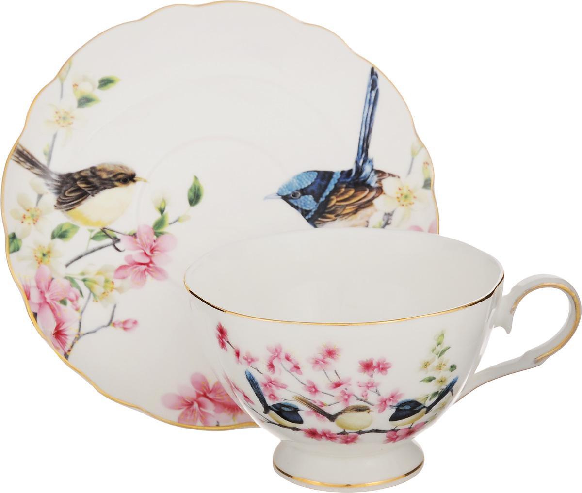 Чайная пара Elan Gallery Райские птички, 2 предмета420023Чайная пара Elan Gallery Райские птички состоит из чашки и блюдца, изготовленных из керамики высшего качества, отличающегося необыкновенной прочностью и небольшим весом. Яркий дизайн, несомненно, придется вам по вкусу. Чайная пара Elan Gallery Райские птички украсит ваш кухонный стол, а также станет замечательным подарком к любому празднику. Не рекомендуется применять абразивные моющие средства. Не использовать в микроволновой печи. Объем чашки: 200 мл. Диаметр чашки (по верхнему краю): 10 см. Высота чашки: 7 см. Диаметр блюдца (по верхнему краю): 15 см. Высота блюдца: 2 см.