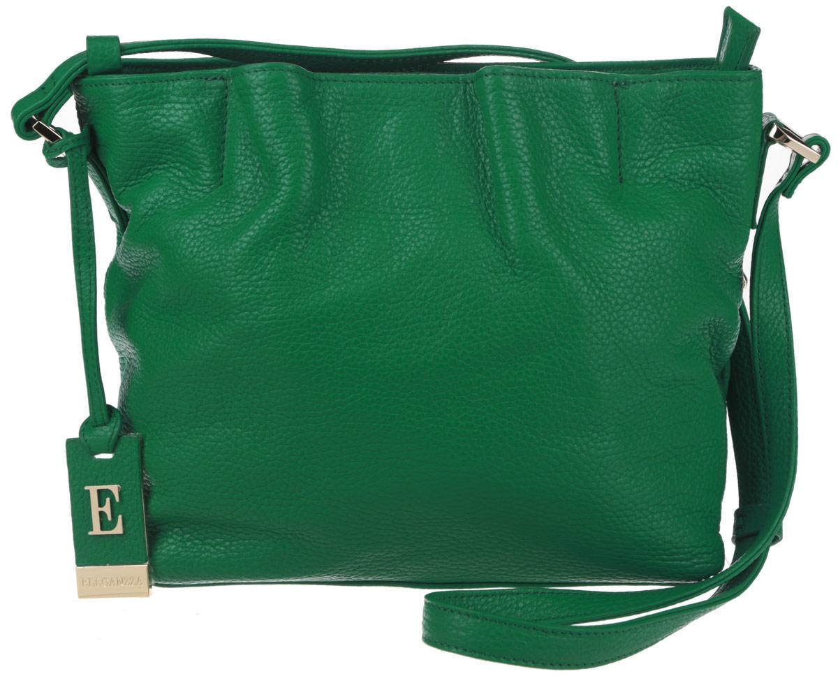 Сумка женская Eleganzza, цвет: зеленый. ZZ-XKB8123-47670-00504Яркая женская сумка торговой марки Eleganzza выполнена из натуральной кожи с зернистой фактурой и застегивается на металлическую застежку-молнию.Сумка содержит два нашивных открытых кармана для мелочей и телефона, врезной карман на пластиковой застежке-молнии и карман-средник на молнии. Снаружи, на лицевой стороне сумки, расположен кармашек на магните. Изделие оснащено несъемным плечевым ремнем, длина которого регулируется металлической пряжкой. Предусмотрены металлические ножки на дне сумки. Изделие декорировано фирменным брелоком с символикой бренда.Прилагается фирменный текстильный чехол для хранения.Оригинальный аксессуар позволит вам завершить образ и быть неотразимой.