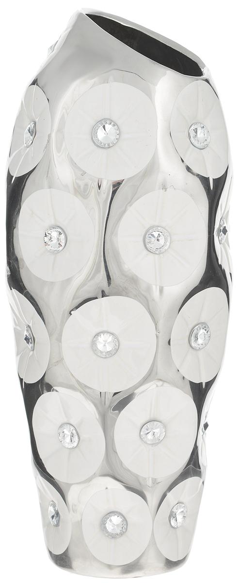 Ваза Sima-land Цветочное сопрано, высота26,5 см94672Ваза Sima-land Цветочное сопрано, изготовленная из высококачественной керамики, декорирована стразами. Интересная форма и необычное оформление сделают эту вазу замечательным украшением интерьера. Она предназначена как для живых, так и для искусственных цветов. На основании изделия имеются противоскользящие накладки. Любое помещение выглядит незавершенным без правильно расположенных предметовинтерьера. Они помогают создать уют, расставить акценты, подчеркнуть достоинства или скрытьнедостатки.
