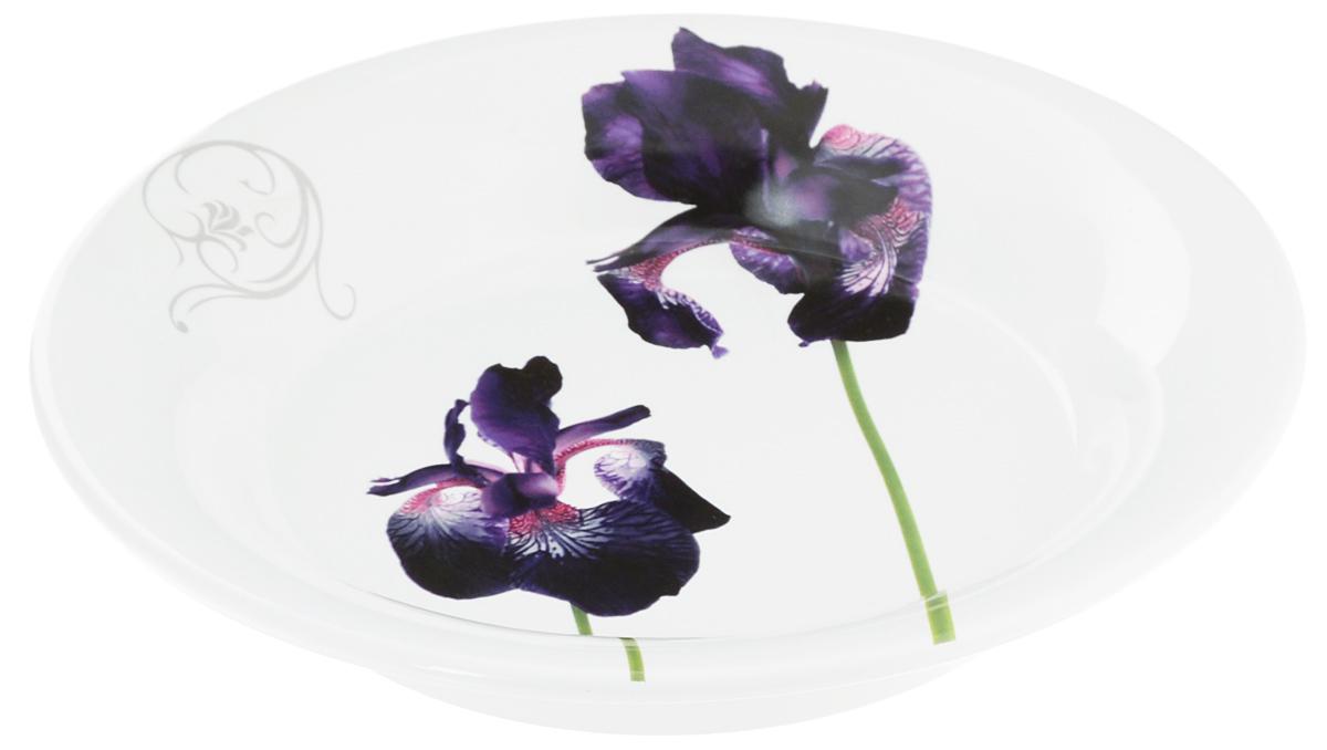 Тарелка глубокая Ceramiche Viva Черный ирис, диаметр 24 см7222.2Глубокая тарелка Ceramiche Viva Черный ирис изготовлена из высококачественной керамики, покрытой слоем сверкающей глазури. Изделие декорировано красочным изображением ирисов. Такая тарелка отлично подойдет в качестве блюда для закусок, нарезок и горячих блюд. Тарелка прекрасно дополнит сервировку стола и порадует вас оригинальным дизайном. Допускается мытье в посудомоечной машине, а также использование для разогрева блюд в СВЧ-печи. Диаметр тарелки: 24 см. Высота стенки: 4 см.