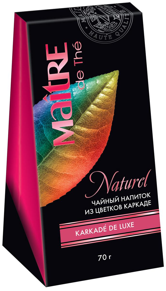 Maitre Karkade de Luxe чайный напиток каркаде, 70 гбай002Отборные целые лепестки и подчашия цветков каркаде (гибискуса). Настой каркаде кисло-сладкий, прозрачный, густого малинового цвета, не содержит кофеин. Горячий напиток прекрасно охлаждает в жару, в холодное время идеален с сахаром.