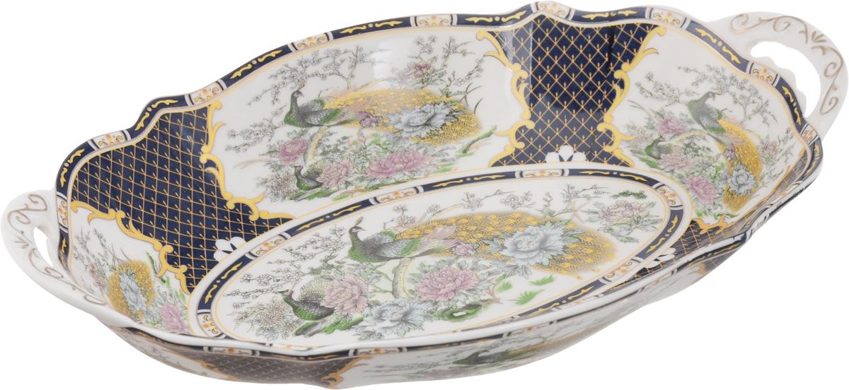 Блюдо Elan Gallery Павлин на золоте, 28 х 19 х 4,5 см740152Блюдо Elan Gallery Павлин на золоте станет изысканным украшением вашего праздничного стола. Изделие выполнено из высококачественной керамики и декорировано красивым рисунком и золотистой эмалью. Размер этого блюда подходит для подачи горячего или шашлыка, а две ручки помогут при подаче на стол. Не использовать в микроволновой печи. Размер блюда (с учетом ручек): 28 х 19 х 4,5 см.