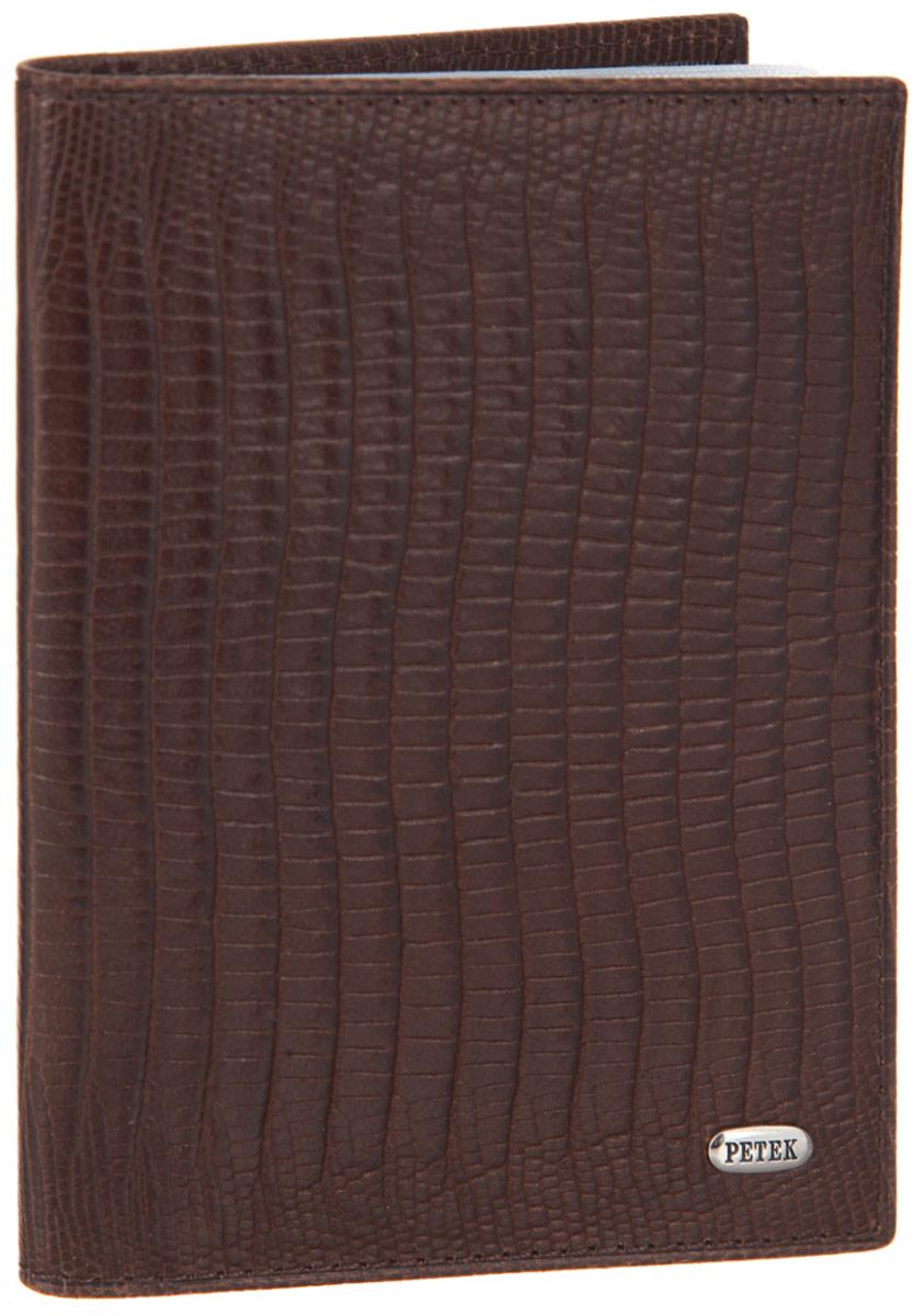 Обложка для автодокументов Petek 1855, цвет: коричневый. 584.041.02A16-11154_711Стильная обложка для автодокументов Petek 1855 изготовлена из натуральной кожи с декоративным фактурным тиснением под кожу рептилии, оформлена металлической пластиной с символикой бренда.Внутри изделия расположены четыре прорезных кармашка для пластиковых карт, сетчатый карман и вкладыш, включающий в себя шесть файлов под автодокументы. Изделие поставляется в фирменной упаковке.Практичная и удобная модель обложки предназначена для тех, кто предпочитает все необходимое хранить в одном месте.