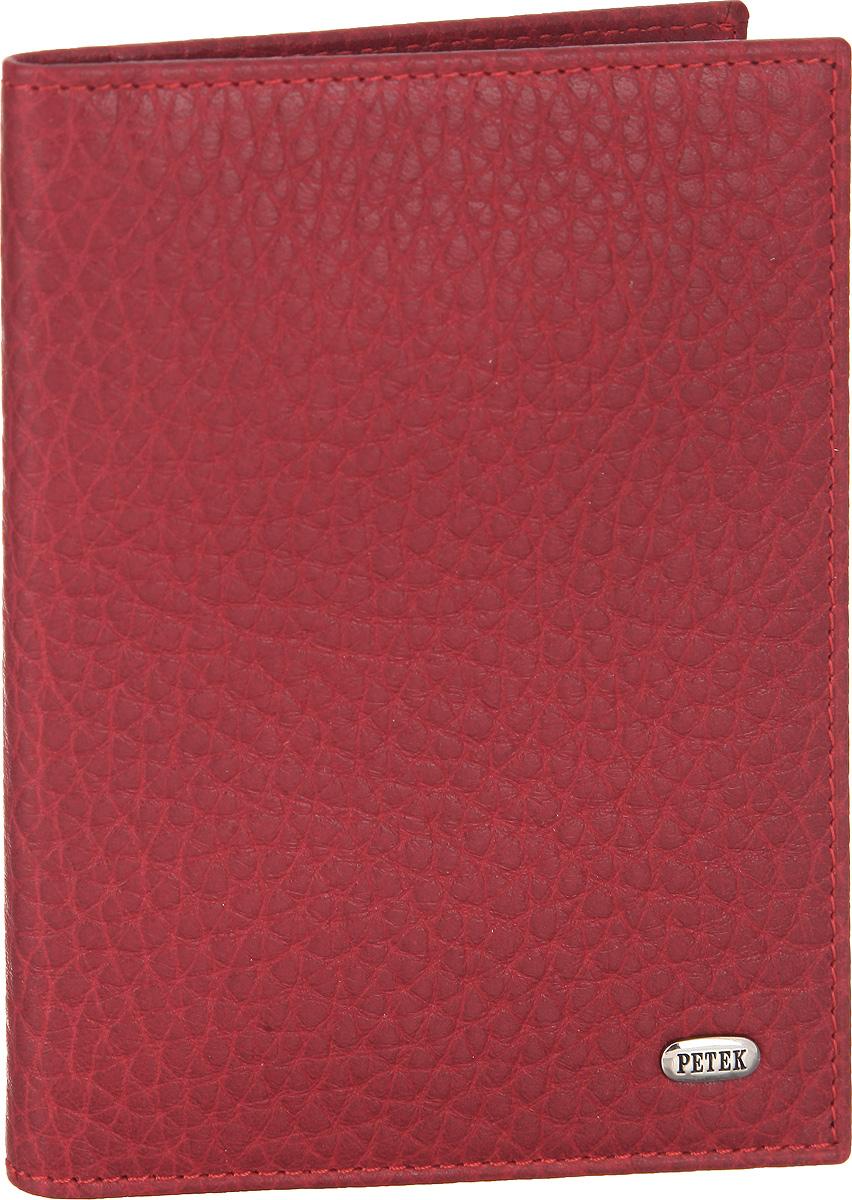 Обложка для автодокументов женская Petek 1855, цвет: красный. 584.46B.10584.46B.10 RedСтильная обложка для автодокументов Petek 1855 изготовлена из натуральной кожи с зернистой фактурой. Лицевая сторона изделия оформлена небольшой металлической пластиной с гравировкой в виде названия бренда. Внутри изделия расположены четыре прорезных кармана для пластиковых карт, сетчатый карман и съемный блок для документов, включающий в себя шесть прозрачных файлов, один из которых формата А5. Изделие поставляется в фирменной упаковке. Обложка для автодокументов поможет сохранить внешний вид ваших документов и защитить их от повреждений, а также станет стильным аксессуаром.