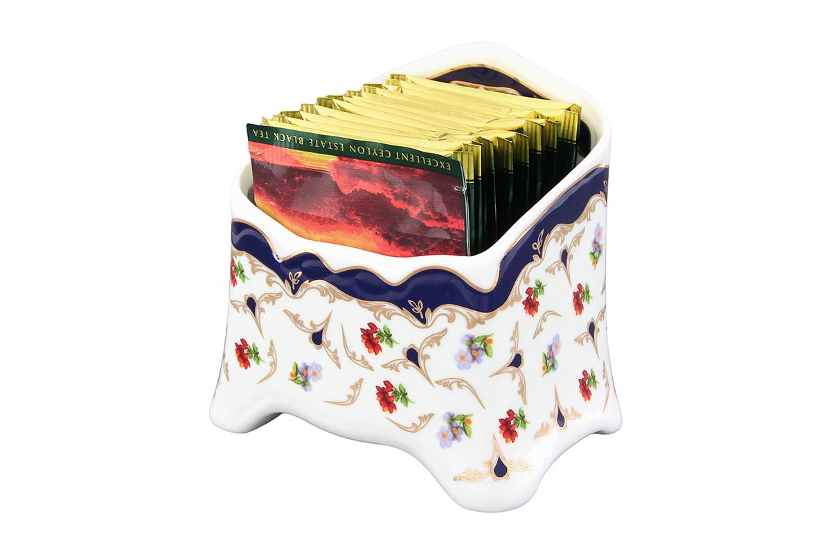Подставка для чайных пакетиков Elan Gallery Цветочек503969Сервировочная подставка для чайных пакетиков Elan Gallery Цветочек, изготовленная из высококачественной керамики, порадует вас оригинальностью и дизайном. Изделие декорировано цветочным рисунком и имеет изысканный внешний вид. Такая подставка, несомненно, понравится любой хозяйке и украсит интерьер любой кухни!