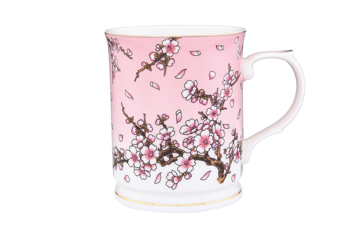 Кружка Elan Gallery Сакура на розовом, 400 мл730549Кружка Elan Gallery Сакура на розовом выполнена из высококачественной керамики и оформлена красочным рисунком. Изделие станет отличным дополнением к сервировке семейного стола, а также замечательным подарком для ваших родных и друзей. Не рекомендуется применять абразивные моющие средства. Объем кружки: 400 мл.