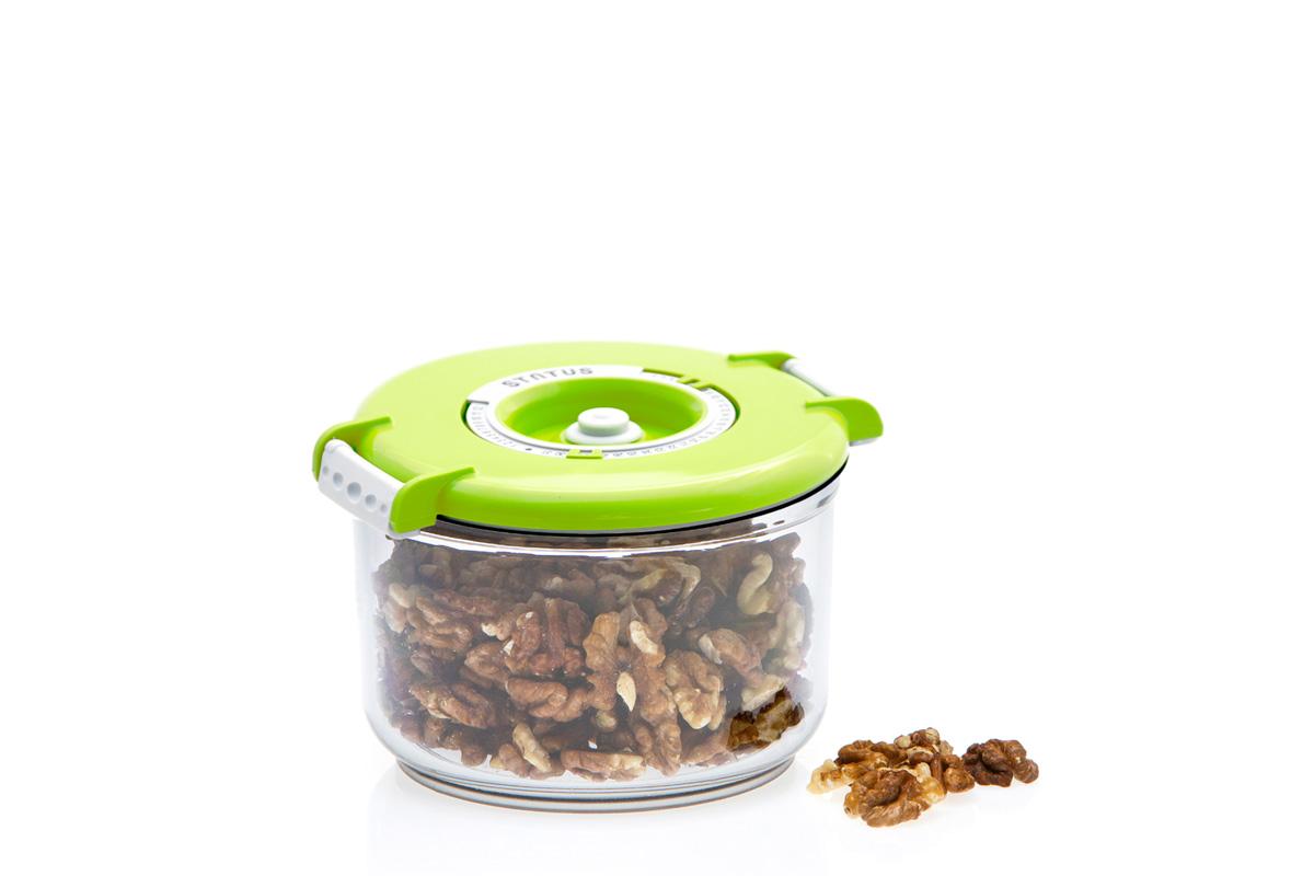 Контейнер вакуумный Status, цвет: прозрачный, зеленый, 0,75 лVAC-RD-075 GreenВакуумный контейнер Status рекомендован для хранения следующих продуктов: фрукты, овощи, хлеб, колбасы, сыры, сладости, соусы, супы. Благодаря использованию вакуумных контейнеров, продукты не подвергаются внешнему воздействию и срок хранения значительно увеличивается. Продукты сохраняют свои вкусовые качества и аромат, а запахи в холодильнике не перемешиваются. Контейнер изготовлен из прочного хрустально-прозрачного тритана. На крышке - индикатор даты (месяц, число). Допускается замораживание (до -21 °C), мойка контейнера в посудомоечной машине, разогрев в СВЧ (без крышки). Объем контейнера: 0,75 л. Размер: 13 х 10 см.