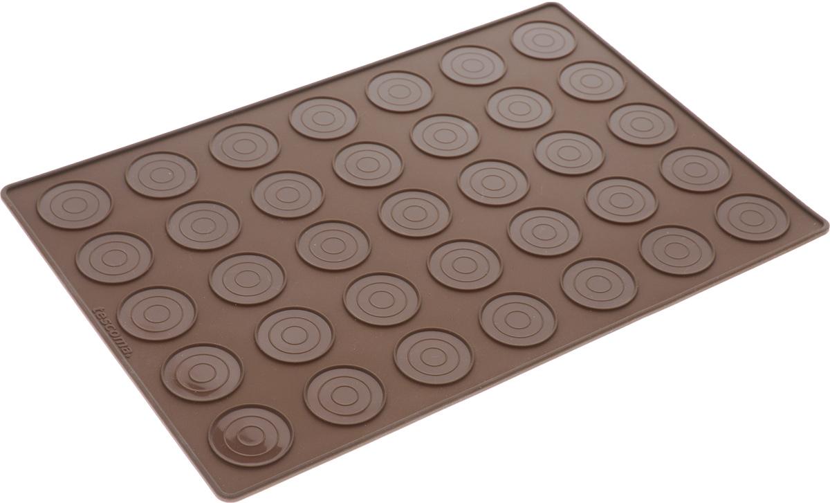 Форма для выпечки макарун Tescoma Delicia, 35 ячеек94672Форма для выпечки макарун Tescoma Delicia изготовлена из высококачественного силикона. Форма содержит 35 неглубоких ячеек.Простая в уходе и долговечная в использовании форма будет верной помощницей в создании ваших кулинарных шедевров. На упаковке имеются рецепты приготовления вкусных десертов.Можно мыть в посудомоечной машине.Размер формы: 32 x 22 х 0,3 см.Диаметр ячейки: 3,5 см.