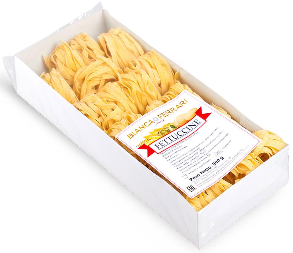 Bianca Ferrari Феттучине паста яичная, 500 гBF.001.OVBianca Ferrari Феттучине - разновидность итальянской домашней пасты из яичного теста. Феттучине такие тонкие и воздушные, что их можно съесть много, не почувствовав тяжести на желудке и лишних килограммов на весах, ведь их готовят только из натуральных продуктов, по выверенной годами рецептуре, исключительно из твердых сортов пшеницы.