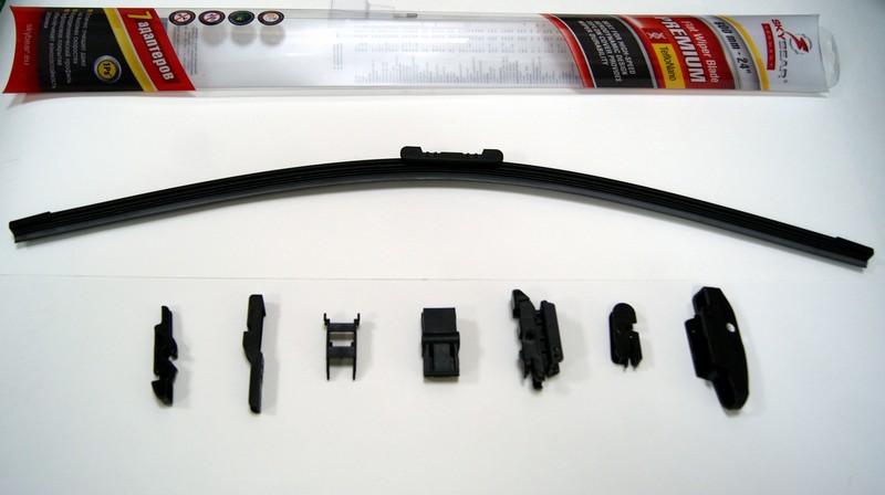 Щетка стеклоочистителя Skybear Premium, бескаркасная, 60 см, 1 шт701240Бескаркасная щетка стеклоочистителя Skybear Premium прекрасно очищает в любую погоду. Тефлоновое покрытие обеспечивает превосходную очистку и увеличивает срок эксплуатации. Щетка обладает аэродинамическим дизайном. Подходит к 95% автомобилей. В комплект входят 7 адаптеров.