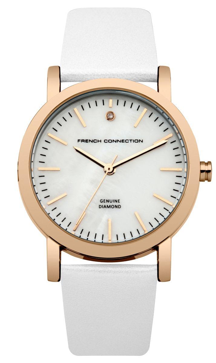 Часы наручные женские French Connection FC, цвет: белый. FC1250WRGFC1250WRGСтильные часы French Connection FC - это модный и практичный аксессуар, который не только выгодно дополнит ваш наряд, но и будет незаменим для каждой современной девушки, ценящей свое время. Корпус выполнен из нержавеющей стали. Перламутровый циферблат оформлен логотипом бренда и украшен инкрустацией натуральным бриллиантом. Корпус изделия имеет степень влагозащиты 3 Bar, оснащен кварцевым механизмом и дополнен устойчивым к царапинам минеральным стеклом. Изысканный ремешок выполнен из натуральной кожи и дополнен пряжкой, которая позволяет с легкостью снимать и надевать изделие. Часы поставляются в фирменной упаковке. Часы French Connection подчеркнут изящество ваших рук и ваш неповторимый стиль и элегантность.