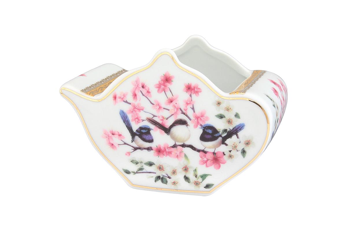 Подставка сервировочная для чайных пакетиков Elan Gallery Чайник. Райские птички, 12 х 9 х 8 см504011Сервировочная подставка для чайных пакетиков Elan Gallery Чайник. Райские птички, изготовленная из высококачественной керамики, порадует вас оригинальностью и дизайном. Изделие имеет изысканный внешний вид. Такая подставка, несомненно, понравится любой хозяйке и украсит интерьер любой кухни!