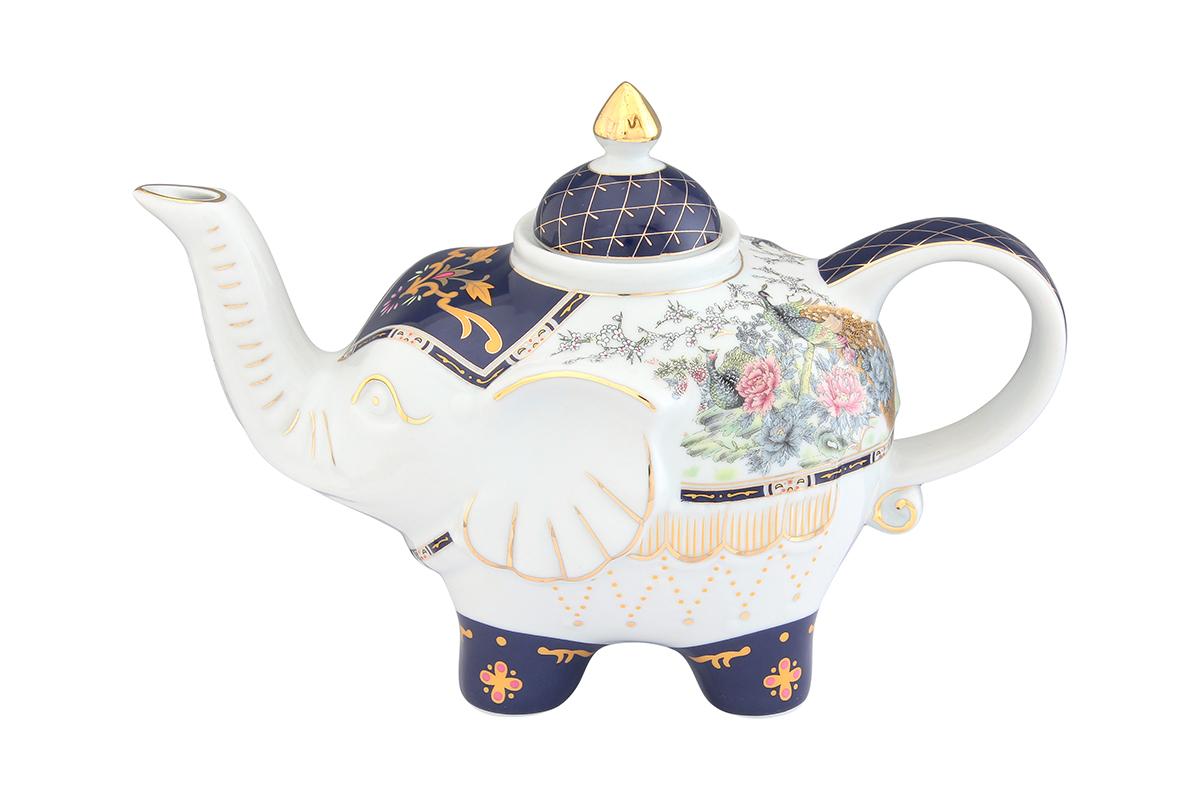 Чайник заварочный Elan Gallery Павлин на золоте, 750 мл94672Загадочная страна Индия: чай, слоны, солнце, праздник! Чайник, выполненный в форме слона, будет напоминать Вам об Индии и наполнит Ваш дом солнечным настроением. Изделие имеет подарочную упаковку, идеальный подарок для Ваших близких!Объем чайника: 750 мл.Размер чайника: 23 х 11 х 15 см.