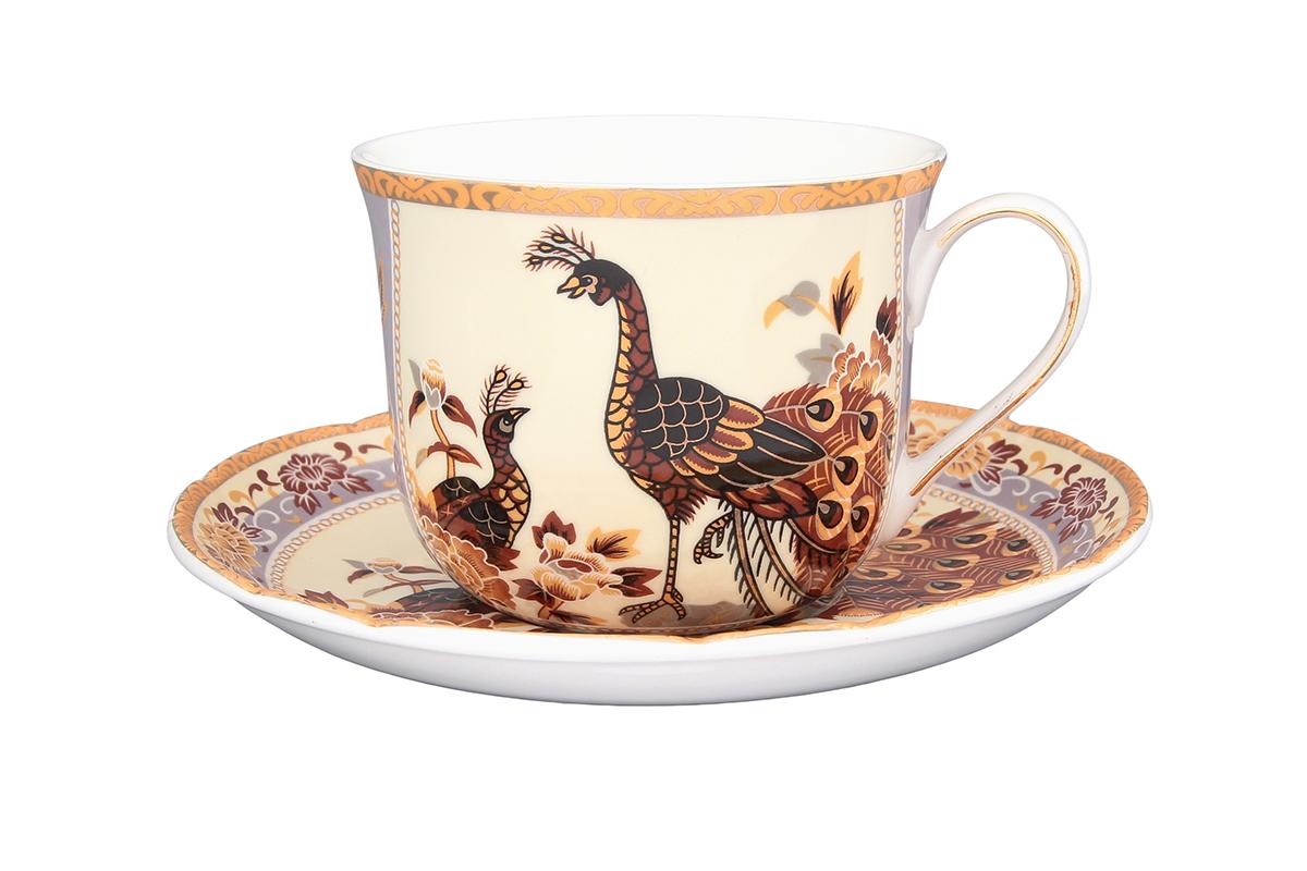 Чайная пара Elan Gallery Павлин на бежевом, 2 предмета730532Чайная пара Elan Gallery Павлин на бежевом состоит из чашки и блюдца, изготовленных из керамики высшего качества. Яркий дизайн, несомненно, придется вам по вкусу. Чайная пара Elan Gallery Павлин на бежевом украсит ваш кухонный стол, а также станет замечательным подарком к любому празднику. Не рекомендуется применять абразивные моющие средства. Не использовать в микроволновой печи. Объем чашки: 400 мл.