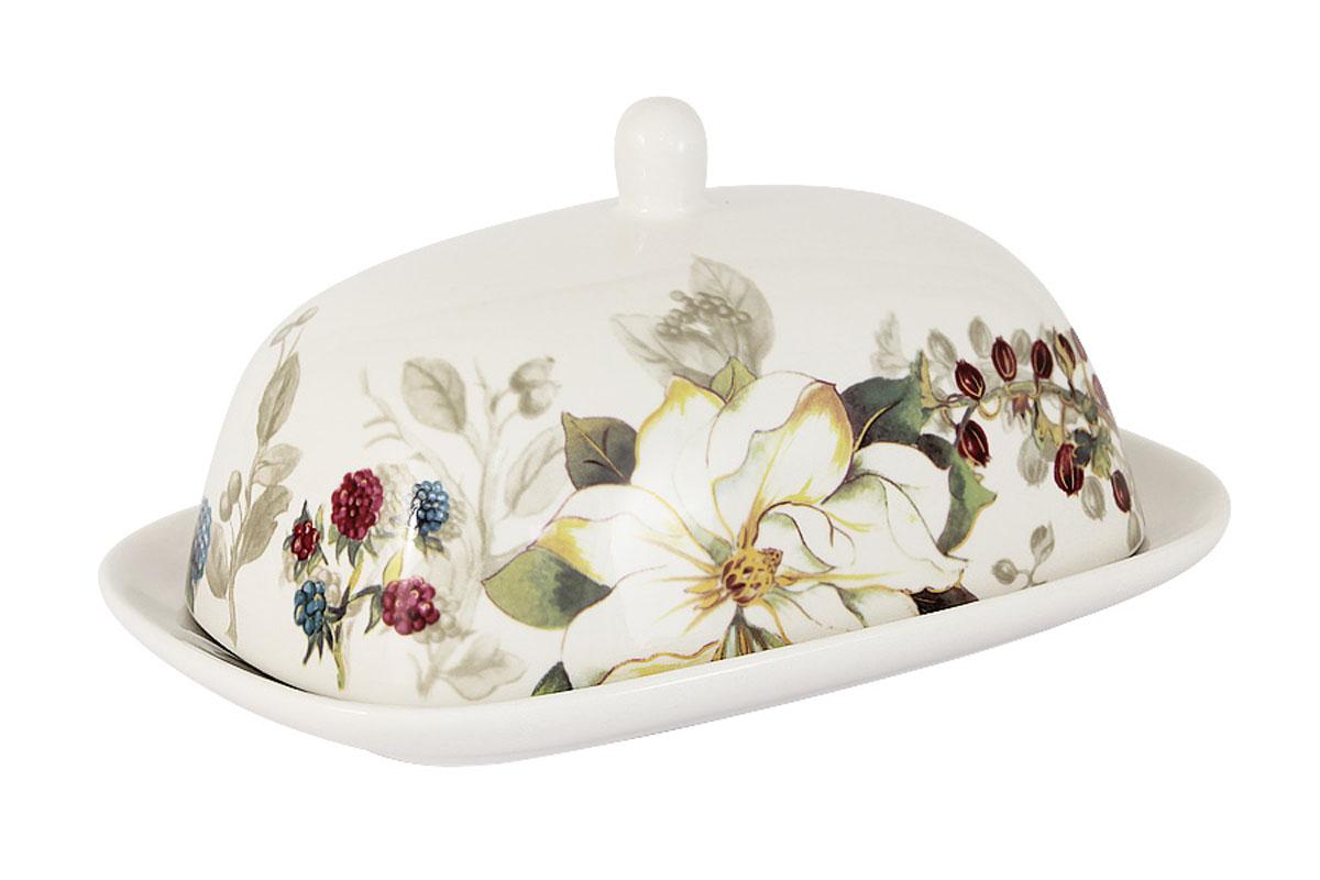 Масленка Imari Магнолия, цвет: белый, зеленый, желтыйVT-1520(SR)Великолепная масленка Imari Магнолия, выполненная из высококачественной керамики, предназначена для красивой сервировки и хранения масла. Она состоит из подноса и крышки. Масло в ней долго остается свежим, а при хранении в холодильнике не впитывает посторонние запахи. Масленка Imari Магнолия идеально подойдет для сервировки стола и станет отличным подарком к любому празднику.Можно мыть в посудомоечной машине. Не использовать в микроволновой печи.Размеры: 18,5 х 12,5 см.