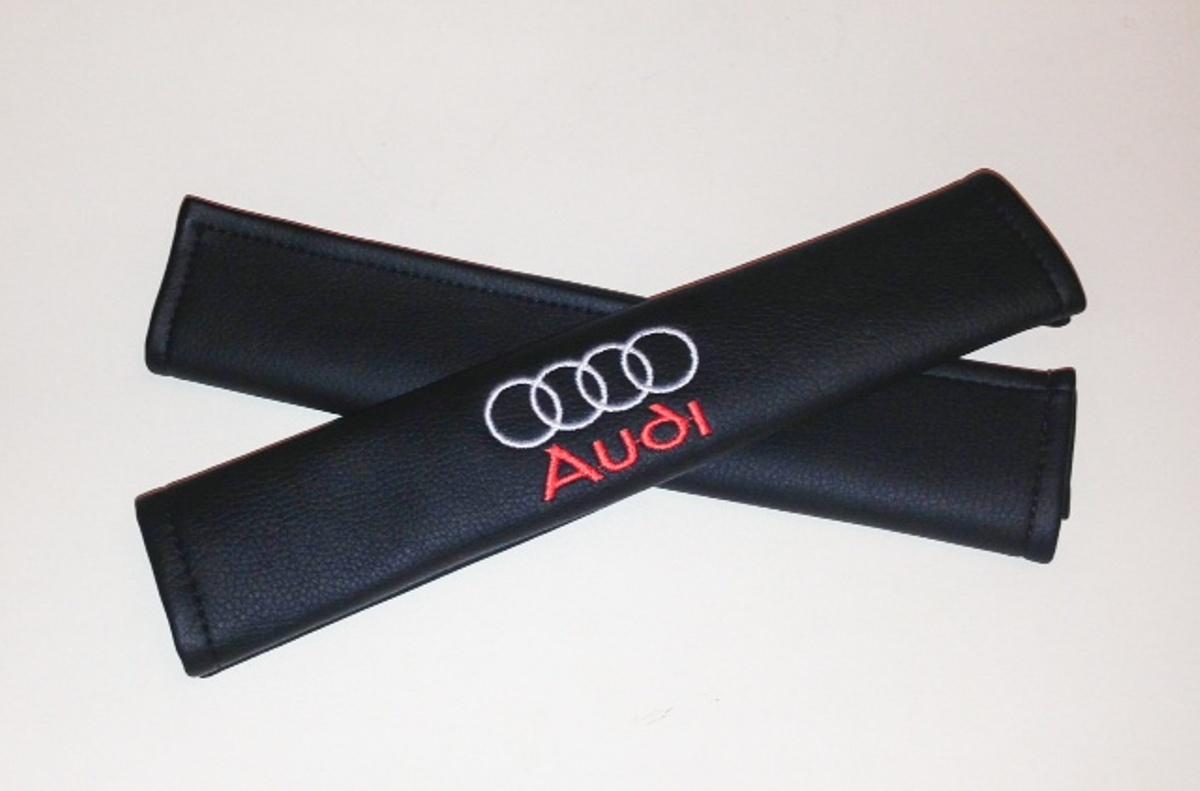 Накладки на ремень безопасности Auto Premium AUDI, 2 шт67001Накладка на ремень безопасности легко закрепляется на ремне и решает ряд назойливых проблем: Ремень больше не натрет плечо, благодаря тому,что накладка сделана из мягкой экокожи и не мешает движению ремня. Накладка на ремень позволит защитить Вашу одежду от следов ремня безопасности. В жаркую погоду в местах соприкосновения с ремнем кожа не будет потеть, так как накладка выполнена из дышащего материала.