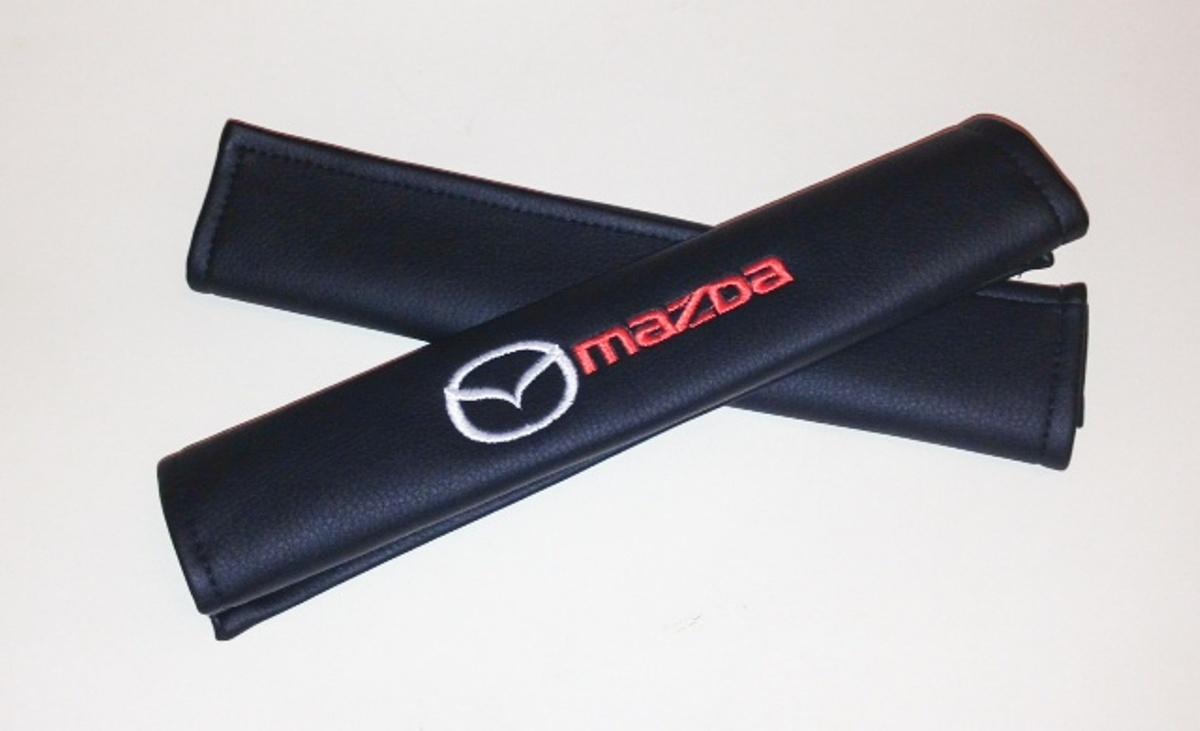 Накладки на ремень безопасности Auto Premium MAZDA, 2 шт67004Накладка на ремень безопасности легко закрепляется на ремне и решает ряд назойливых проблем: Ремень больше не натрет плечо, благодаря тому,что накладка сделана из мягкой экокожи и не мешает движению ремня. Накладка на ремень позволит защитить Вашу одежду от следов ремня безопасности. В жаркую погоду в местах соприкосновения с ремнем кожа не будет потеть, так как накладка выполнена из дышащего материала.
