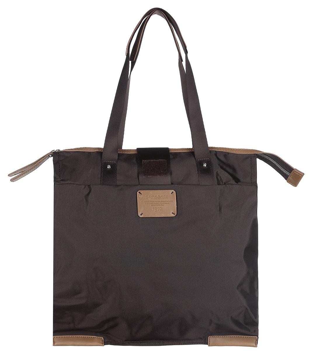 Сумка складная Samsonite, цвет: темно-коричневый. 52V-370013-47670-00504Складная женская сумка Samsonite выполнена из полиамида с добавлением полиуретана и оформлена контрастными вставками и нашивкой логотипа бренда. Изделие содержит одно вместительное отделение, закрывающееся на застежку-молнию. На внешней стороне сумки есть прорезной открытый карман. Сумка оснащена двумя удобными ручками, высота которых позволяет носить сумку как в руке, так и на плече.Сумка не имеет жесткой структуры, за счет чего быстро складывается и фиксируется хлястиком с липучкой и не занимает много места. Такая сумка будет удобна в хранении и в использовании.