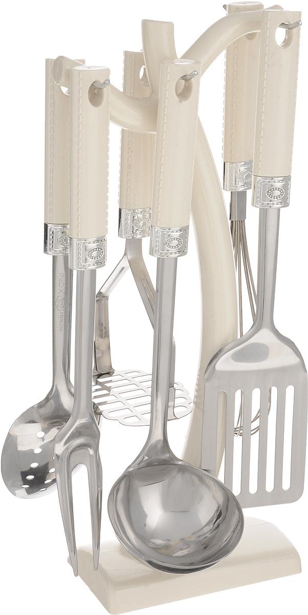 Набор кухонных принадлежностей Mayer & Boch, 7 предметов. 43844384Набор кухонных принадлежностей Mayer & Boch превратит приготовление еды в настоящее удовольствие. Набор состоит из вилки, лопатки с прорезями, венчика, ложки, пресса для картофеля, половника и подставки. Приборы выполнены из высококачественной нержавеющей стали. Нержавеющая сталь идеально подходит для приготовления пищи, она не окисляется со временем и не портит вкус ваших блюд. Изделия снабжены длинными эргономичными нескользящими ручками из пластика цвета слоновой кости, которые защитят ваши руки от ожогов. Этот профессиональный набор очень удобен в использовании и имеет стильную подставку, которая впишется в любой интерьер и позволит хранить приборы в одном месте. Длина вилки: 32 см. Размер рабочей поверхности вилки: 9,5 х 3,5 см. Длина лопатки: 33 см. Размер рабочей поверхности лопатки: 7,5 х 10 см. Длина венчика: 30 см. Размер рабочей поверхности венчика: 5 х 5 х 15 см. Длина ложки: 31 см. Размер рабочей...