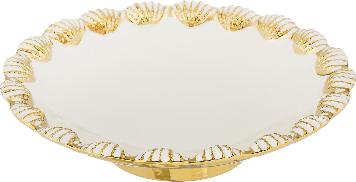 Блюдо Patricia Ракушка, диаметр 31,5 смIM08-0403Оригинальное блюдо Patricia Ракушка - прекрасное дополнение праздничного стола. Изделие, выполненное из высококачественного доломита, оформлено рельефным узором в виде морских ракушек. Блюдо сочетает в себе изысканный дизайн с максимальной функциональностью. Оно идеально подойдет для сервировки стола и станет отличным подарком к любому празднику. Не рекомендуется использовать в микроволновой печи и мыть в посудомоечной машине. Диаметр блюда (по верхнему краю): 31,5 см. Высота блюда: 7 см.