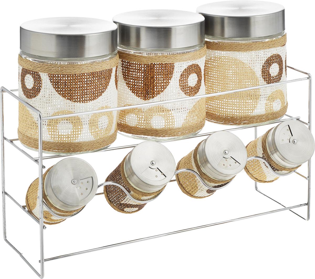 Набор банок для сыпучих продуктов и специй Patricia Круги, с подставкой, 8 предметов. IM99-3906IM99-3906Набор Patricia Круги состоит из 4 банок для специй и 3 для сыпучих продуктов. Банки выполнены из высококачественного стекла и декорированы оригинальной вставкой. Крышки, выполненные из металла, плотно закрываются и предотвращают высыпание специй. Имеются регулируемые отверстия, с помощью которых можно обильно или слегка приправить блюдо. Баночки идеально подойдут для соли, перца и других специй. Изделия размещаются на специальной подставке. Оригинальный набор эффектно украсит интерьер кухни, а также станет незаменимым помощником в приготовлении ваших любимых блюд. С таким набором специи надолго сохранят свежесть, аромат и пряный вкус. Не рекомендуется мыть в посудомоечной машине и использовать в микроволновой печи. Высота баночек (с учетом крышек): 8,5 см, 12,5 см. Диаметр баночек: 3,5 см, 8 см. Размер подставки: 32 х 11 х 17 см.