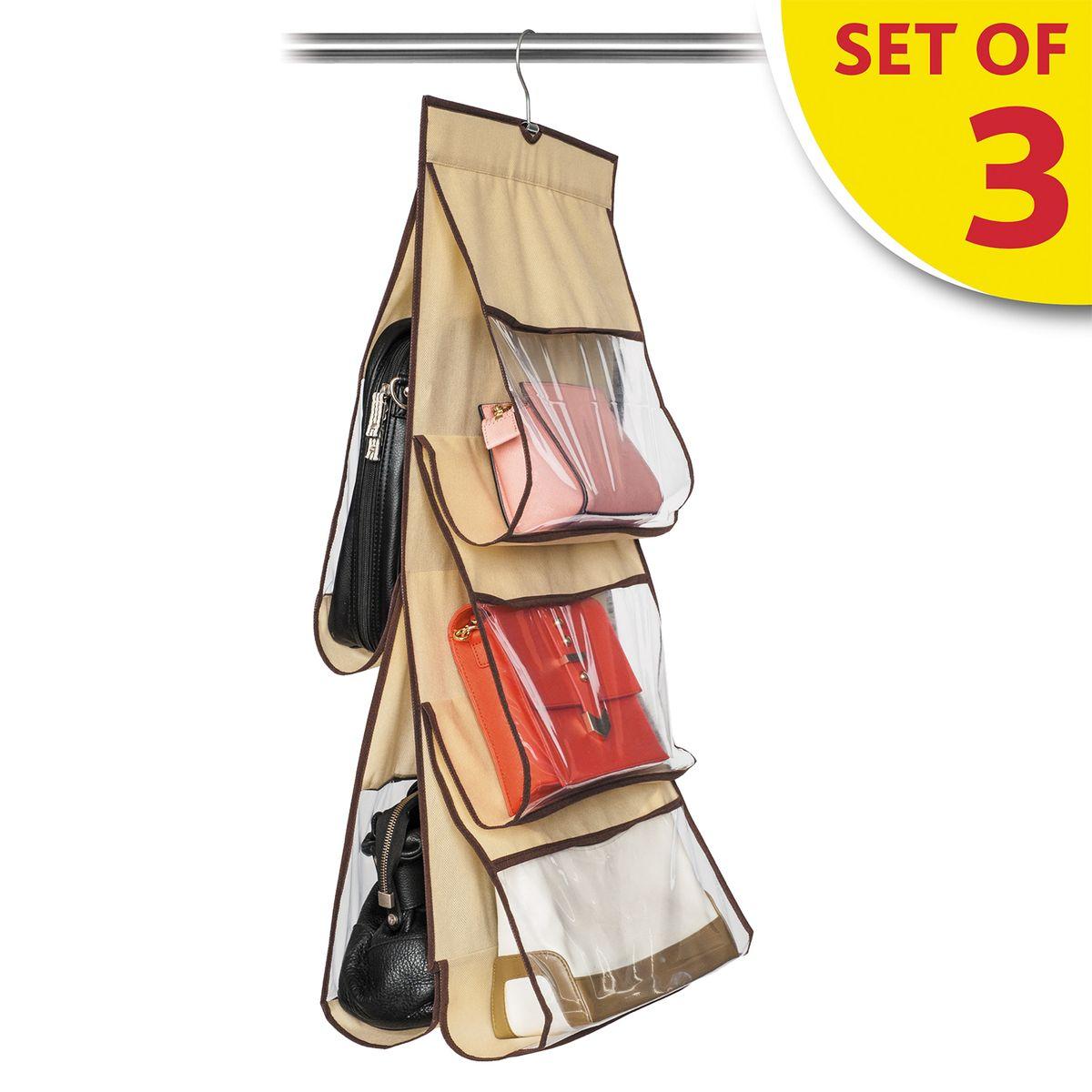 Набор органайзеров для хранения сумок в шкафу Tatkraft Kanga, 3 шт16149Tatkraft KANGA Набор из трех органайзеров для хранения сумок в шкафу. Двусторонний, 5 чехлов-отделений: 2 больших, 3 средних. Мягкий материал защищает кожу от повреждений, прозрачное окошко облегчает поиск сумки. Компактное, удобное и бережное хранение. Размер: 39?84 см.
