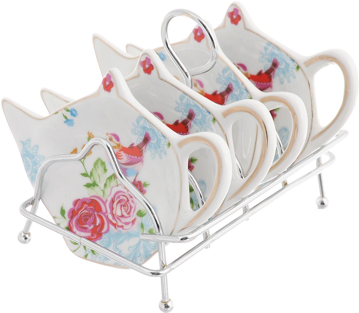 Набор подставок для чайных пакетиков Patricia Райская птичка, 5 предметовIM56-0312Набор подставок Patricia Райская птичка, изготовленный из высококачественного фарфора, порадует вас оригинальностью и дизайном. Подставки выполнены в форме чайничка и оформлены ярким рисунком. В комплект входит металлическая подставка. Можно мыть в посудомоечной машине и использовать в микроволновой печи. Размер подставки для чайных пакетиков: 11,5 х 8 см. Размер металлической подставки: 12 х 9 х 10 см.