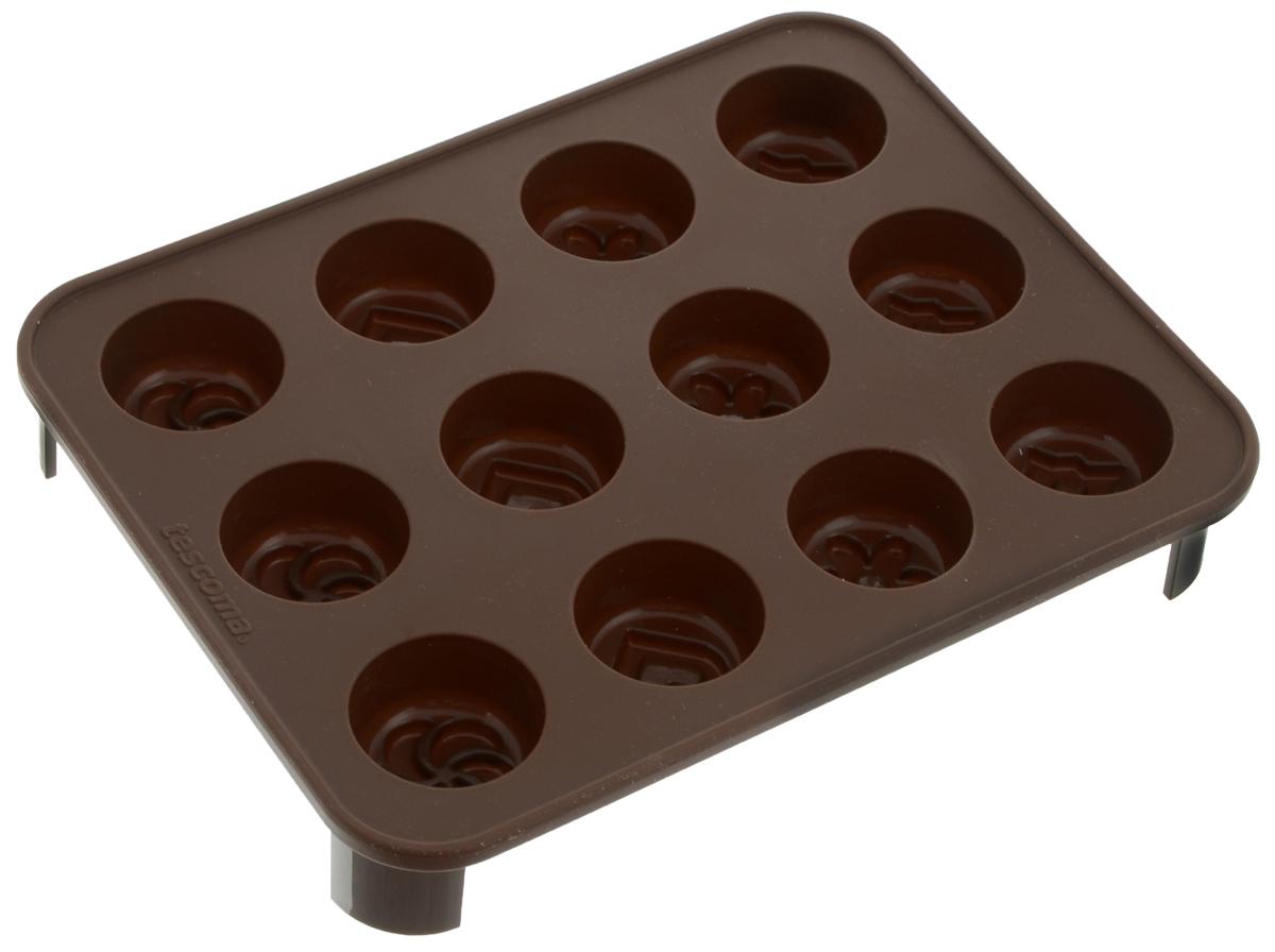 Формочка для шоколада Tescoma Delicia Choco. Шокомикс, с подставкой, 12 ячеек94672Формочка для шоколада Tescoma Delicia Choco. Шокомикс отлично подходит для приготовления шоколадных конфет, шоколадных трюфелей, ароматных кокосок, молочных ирисок и кубиков для льда, а также печенья. Формочка выполнена из высококачественного эластичного термоустойчивого силикона, выдерживающего температуру от -40°С до +230°С. Готовый шоколад не липнет и легко вынимается. Форма имеет 12 круглых ячеек с рельефом в виде сердечка, цветка, звезды и вертушки. Форма поставляется с пластиковой подставкой для хорошей устойчивости. В комплекте - буклет с рецептами. Подходит для микроволновой печи или обычной печи, холодильника, морозильной камеры. Можно мыть в посудомоечной машине.Размер формочки: 18,5 х 14,5 х 2,5 см. Диаметр ячейки: 3,1 см.