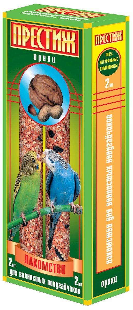 Лакомство для волнистых попугаев Престиж, палочки с орехами, 2 шт0120710Лакомство Престиж для волнистых попугаев в виде жестких палочек с орехами, не только разнообразит корм, но и способствует необходимому уходу за клювом вашего питомца. Регулярное употребление жестких палочек гарантирует очищение и необходимое стачивание клюва. Это лакомство удобно в качестве корма в выходные дни, повесив одну палочку в клетку, вы обеспечите птицу кормом на 2-4 дня.Состав: просо красное, просо белое, просо желтое, овес, льняное семя, семена подсолнечника, канареечное семя, орехи, витамины.Товар сертифицирован.