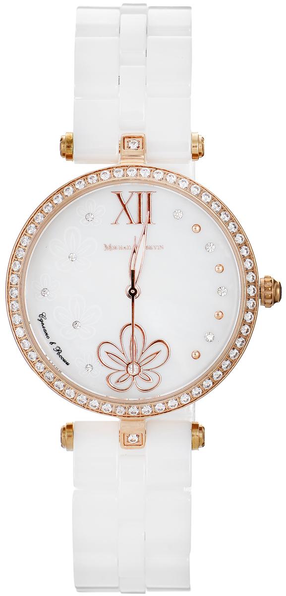 Часы наручные женские Mikhail Moskvin Elegance, цвет: белый, золотой. 1195S18B2INT-06501Стильные женские наручные часы Mikhail Moskvin из серии Elegance изготовлены из высокотехнологичной гипоаллергенной нержавеющей стали и дополнены изящным, высокопрочным керамическим браслетом. Для того чтобы защитить циферблат от повреждений в часах используется высокопрочное сапфировое стекло. Циферблат изделия оснащен часовой, минутной и секундной стрелками, оформлен символикой бренда. Тонкий ободок из сверкающих стразов обрамляет перламутровый циферблат. На мерцающей поверхности на месте индикации часов - восхитительный орнамент из цветов и чередующиеся золотые и сверкающие круглые знаки. Золотые заостренные стрелки заполнены белой массой.Браслет комплектуется надежной и удобной в использовании застежкой-бабочкой, которая позволит с легкостью снимать и надевать часы.Часы упакованы в фирменную коробку с прозрачным окошком и дополнительно в текстильную сумку с названием бренда.Часы Mikhail Moskvin подчеркнут характер и отменное чувство стиля их обладателя.