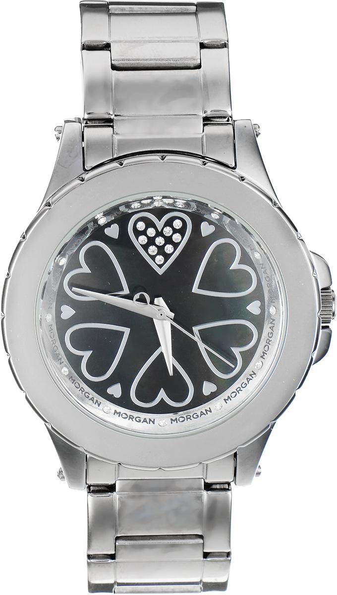 Часы наручные женские Morgan, цвет: стальной. M1128BMBKM1128BMBKЭлегантные часы Morgan выполнены из стали, инкрустированы сияющими чешскими кристаллами и оформлены символикой бренда. Циферблат украшен вставкой из перламутра. Лаконичный корпус часов надежно защищен устойчивым к царапинам минеральным стеклом. Часы оснащены кварцевым механизмом, дополнены изящным браслетом, который застегивается на замок-клипсу. Изделие поставляется в фирменной упаковке. Часы Morgan подчеркнут изящество женской руки и отменное чувство стиля у их обладательницы.