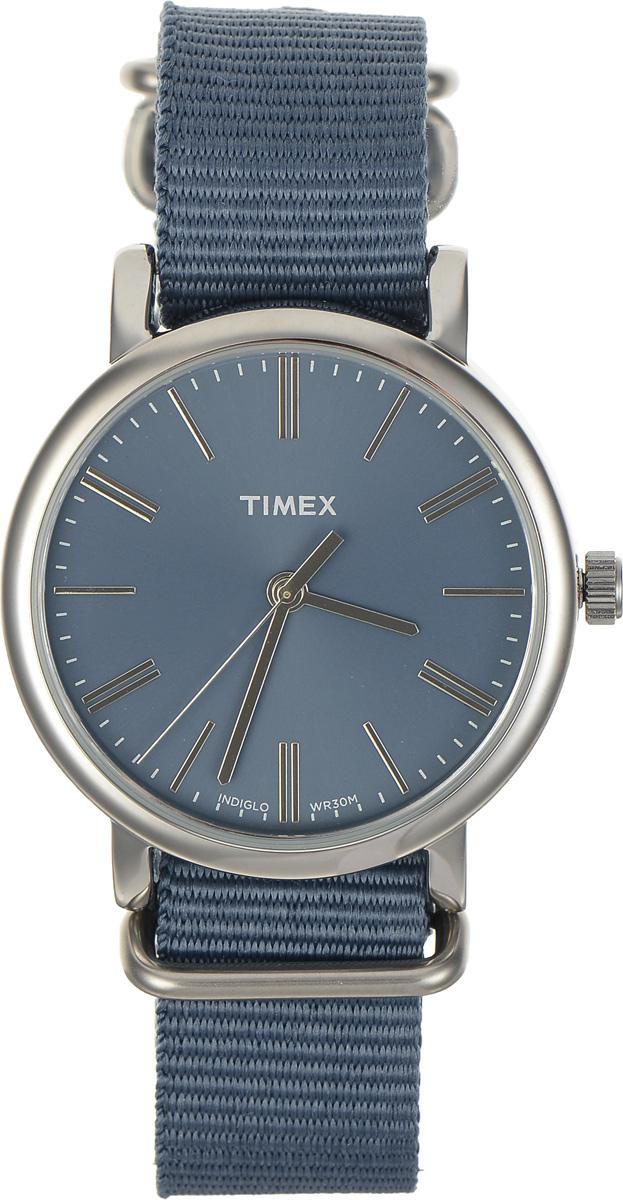 Часы наручные женские Timex Originals, цвет: серебристый, синий. TW2P88700BP-001 BKСтильные часы Timex Originals выполнены из нержавеющей стали и минерального стекла. Циферблат оснащен запатентованной электролюминесцентной подсветкой INDIGLO и оформлен символикой бренда.Корпус изделия имеет степень влагозащиты 3 Bar, оснащен кварцевым механизмом и дополнен устойчивым к царапинам минеральным стеклом. Ремешок современного дизайна выполнен из нейлона и оснащен пряжкой, которая позволит с легкостью снимать и надевать изделие.Часы поставляются в фирменной упаковке.Часы Timex Originals подчеркнут изящество женской руки и отменное чувство стиля у их обладательницы.