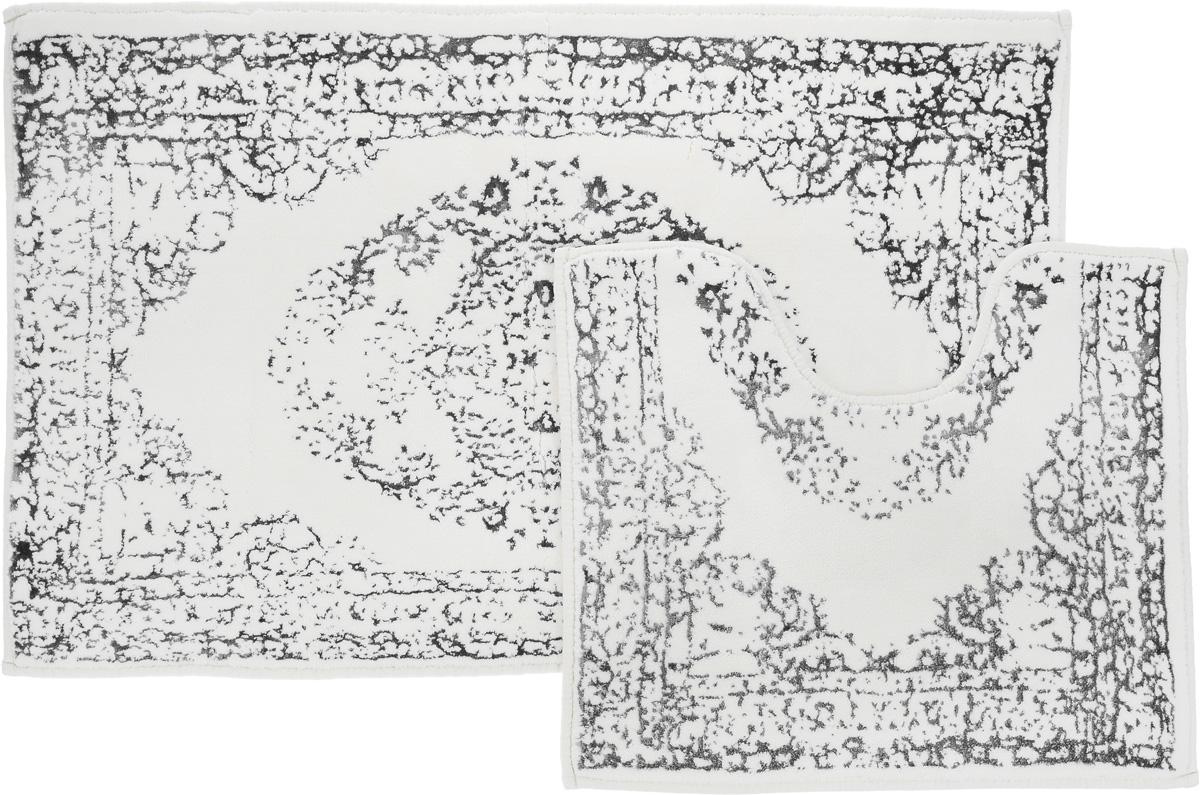 Набор ковриков для ванной Arya Venus, цвет: серый, молочный, 2 штTR1001005СерыйНеобыкновенные коврики для ванной Arya Venus обладают эффектным дизайном, мягким и легким в уходе ворсом, нежным естественным оттенком, а также насыщенным цветом. Набор состоит из двух ковриков, выполненных из хлопка и вискозы. Верхняя часть из ворса 4 мм. Коврики украшены рисунком, который придаст еще большей элегантности дизайну ванной комнаты. Особенности изделий: Края ковриков обработаны. Коврики не требовательны в уходе, если они чрезмерно не пачкаются и не загрязняются. В зависимости от интенсивности использования достаточно раз в месяц или в три месяца привести их в порядок. Коврики легко сворачиваются или складываются и помещаются в емкость для стирки. Данные коврики легко выдержат машинную стирку на бережном цикле при 30°С. Хорошо впитывают влагу, быстро сохнут. Коврик - это необходимый предмет, без которого невозможен комфорт и уют в ванной комнате. Размер ковриков: 60 х 100 см, 50 х 60 см.