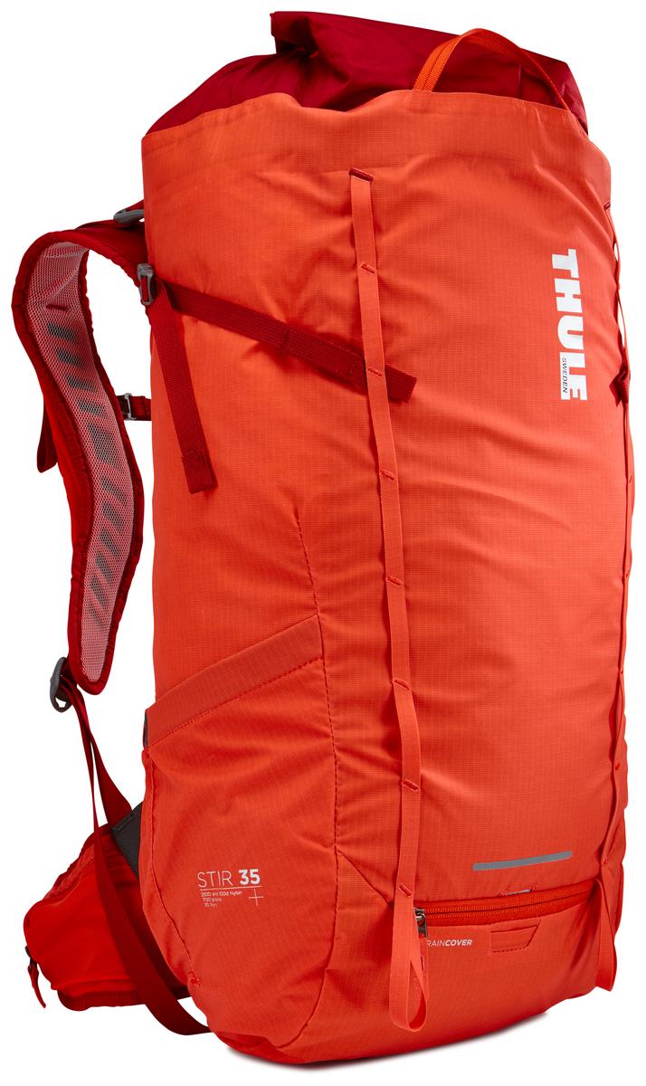 Рюкзак мужской Thule Stir 35L, цвет: оранжевый, 35 л800801Мужской рюкзак для пеших путешествий Thule Stir с объемом 35 л. Благодаря простому и элегантному дизайну в сочетании с регулировкой рюкзака по спине, множеством легкодоступных карманов и дождевым чехлом этот рюкзак идеально подходит для более долгих дневных походов. Легкодоступная крышка с защитным откидным клапаном. Система StormGuard - это комбинация частичного дождевого чехла с водонепроницаемым нижним слоем для создания полностью защищенного от непогоды рюкзака. Конструкция StormGuard обеспечивает удобный доступ к снаряжению, препятствует проникновению влаги и более надежна, чем обычный дождевой чехол. Регулировка по спине в пределах 10 см обеспечивает идеальную посадку. Съемные поясной и нагрудный ремни для городского использования. Боковая молния для удобного доступа к снаряжению. Эластичный карман на плечевом ремне для хранения телефона и других небольших предметов. Точка крепления петли для фонаря и светоотражающий материал. Передний карман Shove-it Pocket для быстрого доступа. Две петли-крепления для треккинговых палок или ледорубов.