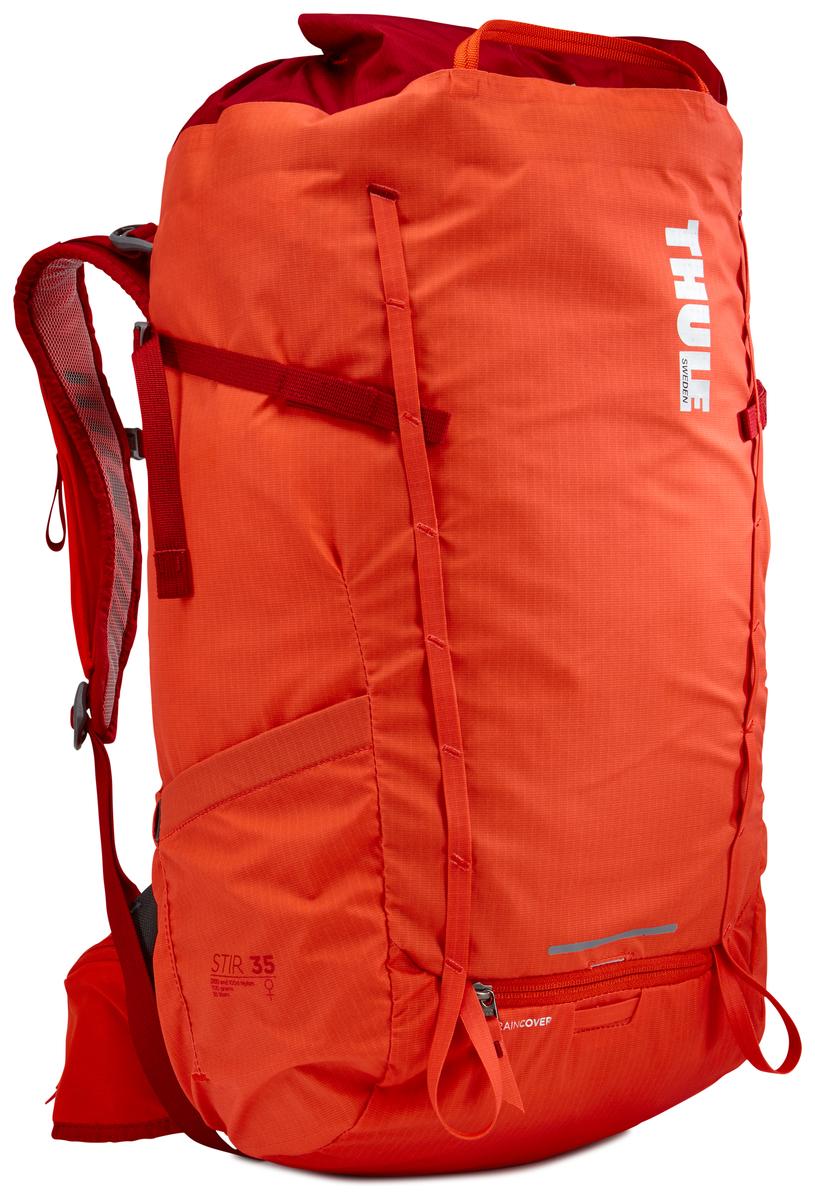 Рюкзак женский Thule Stir 35L, цвет: оранжевый, 35 лa026124Женский рюкзак для пеших путешествий Thule Stir с объемом 35 л. Благодаря простому и элегантному дизайну в сочетании с регулировкой рюкзака по спине, множеством легкодоступных карманов и дождевым чехлом этот рюкзак идеально подходит для более долгих дневных походов. Легкодоступная крышка с защитным откидным клапаном. Система StormGuard - это комбинация частичного дождевого чехла с водонепроницаемым нижним слоем для создания полностью защищенного от непогоды рюкзака. Конструкция StormGuard обеспечивает удобный доступ к снаряжению, препятствует проникновению влаги и более надежна, чем обычный дождевой чехол. Регулировка по спине в пределах 10 см обеспечивает идеальную посадку. Съемные поясной и нагрудный ремни для городского использования. Боковая молния для удобного доступа к снаряжению. Эластичный карман на плечевом ремне для хранения телефона и других небольших предметов. Точка крепления петли для фонаря и светоотражающий материал. Передний карман Shove-it Pocket для быстрого доступа. Две петли-крепления для треккинговых палок или ледорубов.