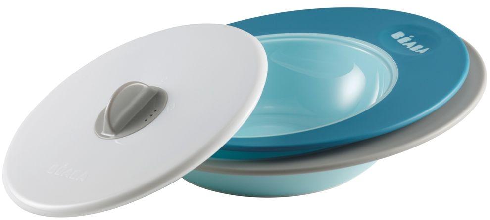 Beaba Набор тарелок для кормления Ellipse цвет голубой синий4С0467Специальная форма тарелок Ellipse - сохраняет еду ребенка теплой длительное время. Набор тарелок: две тарелки и крышка.Объем тарелок:тарелка - 210 мл,глубока тарелка – 300 млИспользование с 6 месяцев.Набор тарелок имеет два положения крышки. Тарелки имеют высокие и широкие края для удобного перемешивания, их выгнутое дно предназначено для естественного распределения пищи по тарелке и удобного захвата ребенком. Тарелки можно использовать в микроволновой печи, они прекрасно сохраняют тепло.Имеют нескользящее основание.