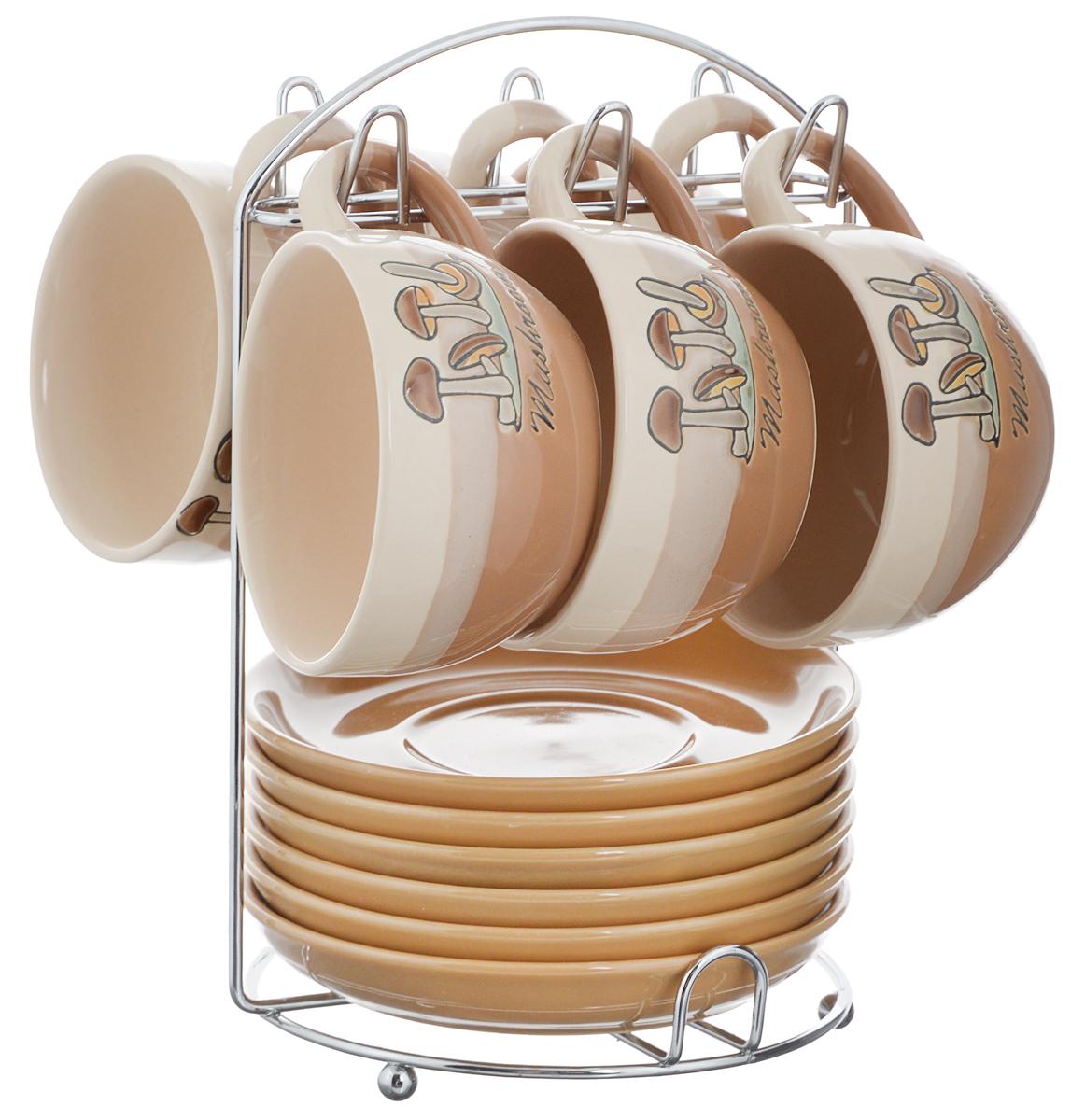 Набор чайный Calve. Грибы, на подставке, 13 предметов115610Набор Calve. Грибы состоит из шести чашек и шести блюдец, изготовленных из высококачественного фарфора. Чашки оформлены ярким изображением грибов. Изделия расположены на металлической подставке. Такой набор подходит для подачи чая или кофе.Изящный дизайн придется по вкусу и ценителям классики, и тем, кто предпочитает утонченность и изысканность. Он настроит на позитивный лад и подарит хорошее настроение с самого утра. Чайный набор Calve. Грибы - идеальный и необходимый подарок для вашего дома и для ваших друзей в праздники.Можно мыть в посудомоечной машине. Объем чашки: 220 мл. Диаметр чашки (по верхнему краю): 9,5 см. Высота чашки: 6,3 см. Диаметр блюдца: 14,5 см. Высота блюдца: 2,3 см.Размер подставки: 16,5 х 16 х 22,5 см.