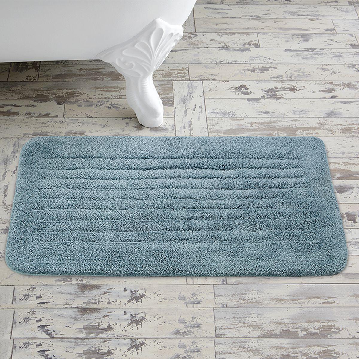Коврик для ванной Togas Аква, 50 х 80 см10.00.08.0022Коврик для ванной Togas Аква выполнен из натурального 100% хлопка. Элегантный дизайн, исключительная мягкость и прочность хлопковых нитей, использованных для изготовления этого изделия делают его неподражаемым. Коврик для ванной Togas Аква прост в уходе, обладает высокой степенью впитываемости, не образует катышков даже после многократных стирок, что подтверждается его внешней эластичностью и гладкостью.