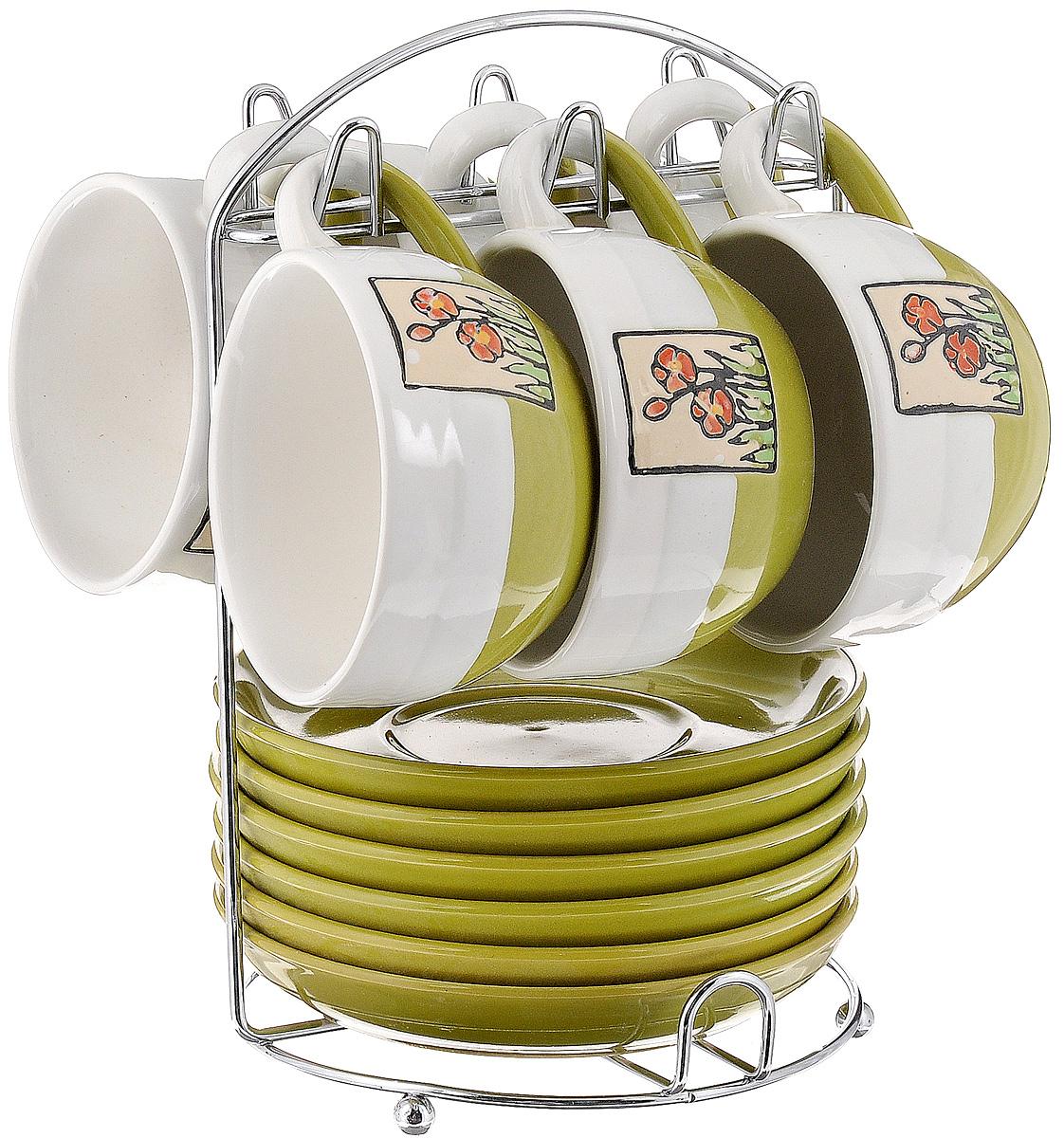Набор чайный Calve. Маки, на подставке, 13 предметовCL-2022_белый, оливковыйНабор Calve. Маки состоит из шести чашек и шести блюдец, изготовленных из высококачественного фарфора. Чашки оформлены цветочными изображениями. Изделия расположены на металлической подставке. Такой набор подходит для подачи чая или кофе. Изящный дизайн придется по вкусу и ценителям классики, и тем, кто предпочитает утонченность и изысканность. Он настроит на позитивный лад и подарит хорошее настроение с самого утра. Чайный набор Calve. Маки - идеальный и необходимый подарок для вашего дома и для ваших друзей в праздники. Можно мыть в посудомоечной машине. Объем чашки: 220 мл. Диаметр чашки (по верхнему краю): 9,5 см. Высота чашки: 6,3 см. Диаметр блюдца: 14,5 см. Высота блюдца: 2,3 см. Размер подставки: 16,5 х 16 х 22,5 см.