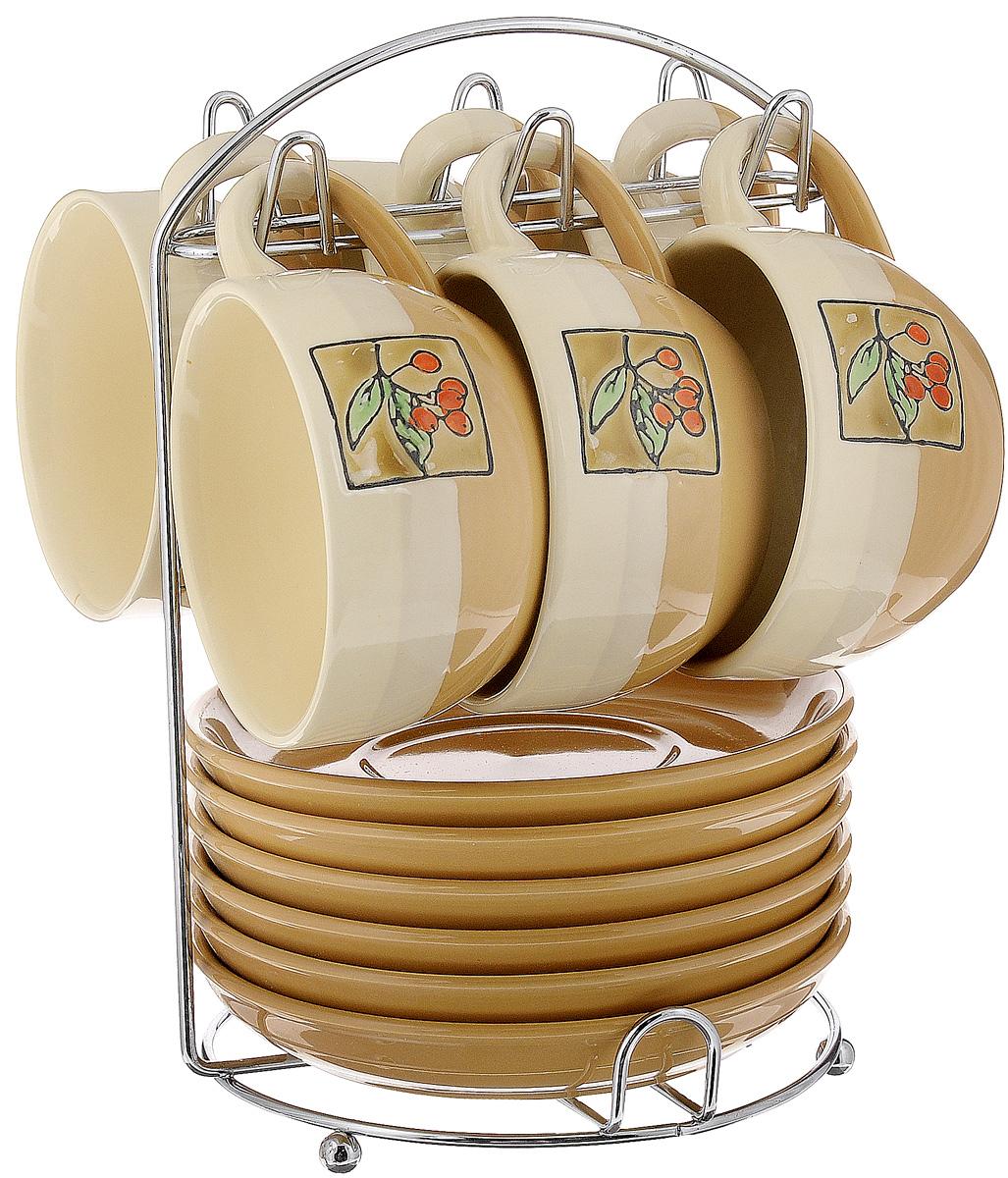 Набор чайный Calve. Ягоды, на подставке, 13 предметовCL-2022_бежевый, коричневый, оранжевыйНабор Calve. Ягоды состоит из шести чашек и шести блюдец, изготовленных из высококачественного фарфора. Чашки оформлены красочным рисунком. Изделия расположены на металлической подставке. Такой набор подходит для подачи чая или кофе. Изящный дизайн придется по вкусу и ценителям классики, и тем, кто предпочитает утонченность и изысканность. Он настроит на позитивный лад и подарит хорошее настроение с самого утра. Чайный набор Calve. Ягоды - идеальный и необходимый подарок для вашего дома и для ваших друзей в праздники. Можно мыть в посудомоечной машине. Объем чашки: 220 мл. Диаметр чашки (по верхнему краю): 9,5 см. Высота чашки: 6,3 см. Диаметр блюдца: 14,5 см. Высота блюдца: 2,3 см. Размер подставки: 16,5 х 16 х 22,5 см.