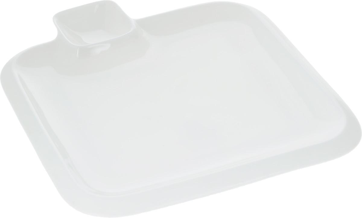 Блюдо Wilmax, 20 х 20 смWL-992653 / AОригинальное блюдо Wilmax, выполненное из высококачественного фарфора, имеет квадратную форму и оснащено соусником. Изделие идеально подойдет для сервировки праздничного или обеденного стола, а также станет отличным подарком к любому празднику. Размер блюда (по верхнему краю): 20 х 20 см. Высота стенки блюда: 2 см. Размер соусника (по верхнему краю): 5,2 х 5,2 см. Высота стенки соусника: 2,3 см. Ширина блюда (с учетом соусника): 23 см.