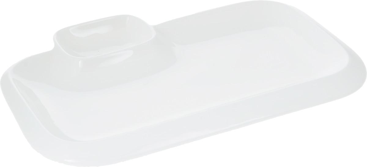 Блюдо Wilmax, 20 х 12 смWL-992573 / AОригинальное блюдо Wilmax, выполненное из высококачественного фарфора, имеет прямоугольную форму и оснащено соусником. Изделие идеально подойдет для сервировки праздничного или обеденного стола, а также станет отличным подарком к любому празднику. Размер блюда (по верхнему краю): 20 х 12 см. Высота стенки блюда: 2 см. Размер соусника (по верхнему краю): 7,2 х 5,5 см. Высота стенки соусника: 2,5 см. Ширина блюда (с учетом соусника): 17 см.