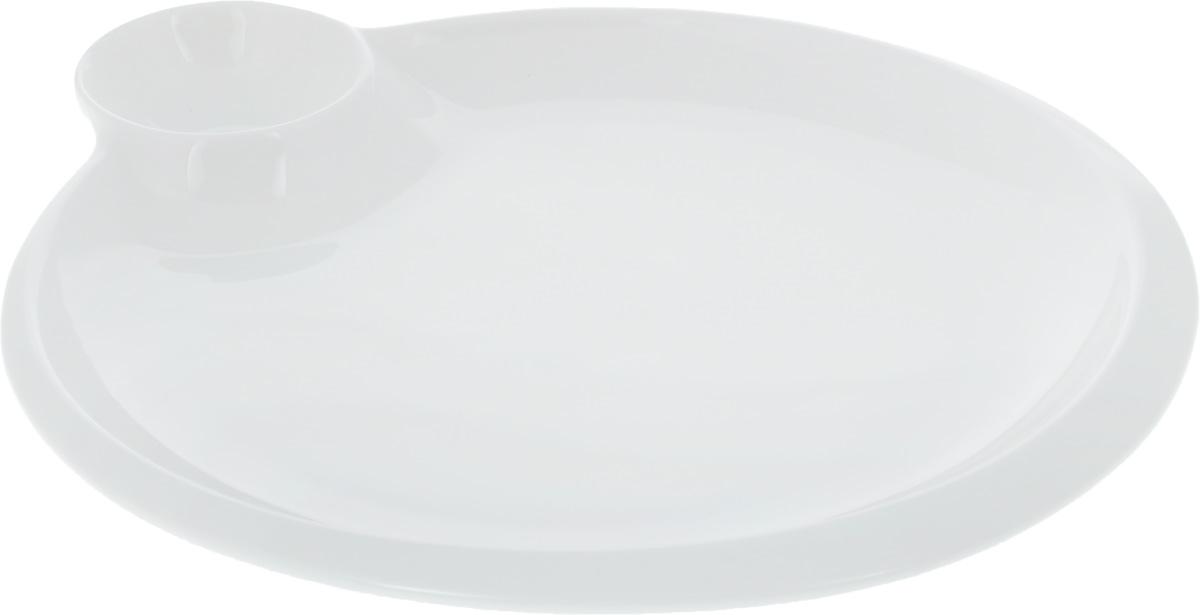 Блюдо Wilmax, диаметр 25 см. WL-992580 / AWL-992580 / AОригинальное блюдо Wilmax, выполненное из высококачественного фарфора, имеет классическую круглую форму и оснащено соусником. Изделие идеально подойдет для сервировки праздничного или обеденного стола, а также станет отличным подарком к любому празднику. Диаметр блюда (по верхнему краю): 25 см. Диаметр соусника: 6,5 см.
