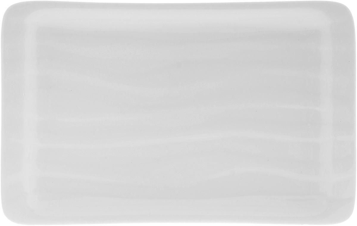 Блюдо Wilmax, 22 х 14 смWL-992592 / AОригинальное прямоугольное блюдо Wilmax, изготовленное из фарфора с глазурованным покрытием, прекрасно подойдет для подачи нарезок, закусок и других блюд. Оно украсит ваш кухонный стол, а также станет замечательным подарком к любому празднику. Размер блюда: 22 х 14 см.