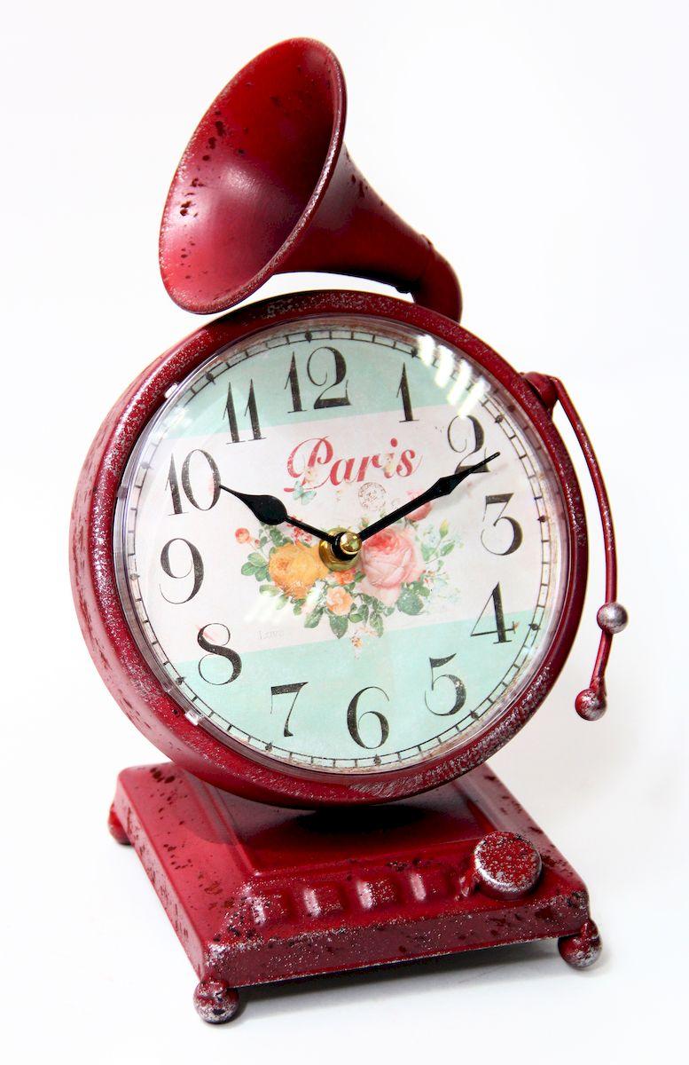 Часы настольные Magic Home Граммофон, кварцевые, цвет: красный54 009303Настольные кварцевые часы Magic Home Граммофон изготовлены из металла, циферблат с покрытием из принтованной бумаги. Настольные часы Magic Home Граммофон прекрасно оформят интерьер дома или рабочий стол в офисе.Часы работают от одной батарейки типа АА мощностью 1,5V (не входит в комплект).