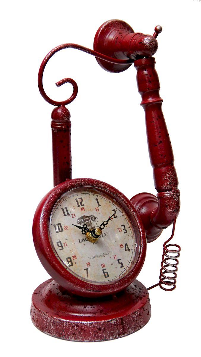 Часы настольные Magic Home Телефон, кварцевые, цвет: красный41493Настольные кварцевые часы Magic Home Телефон изготовлены из металла, циферблат с покрытием из принтованной бумаги. Настольные часы Magic Home Телефон прекрасно оформят интерьер дома или рабочий стол в офисе. Часы работают от одной батарейки типа АА мощностью 1,5V (не входит в комплект).