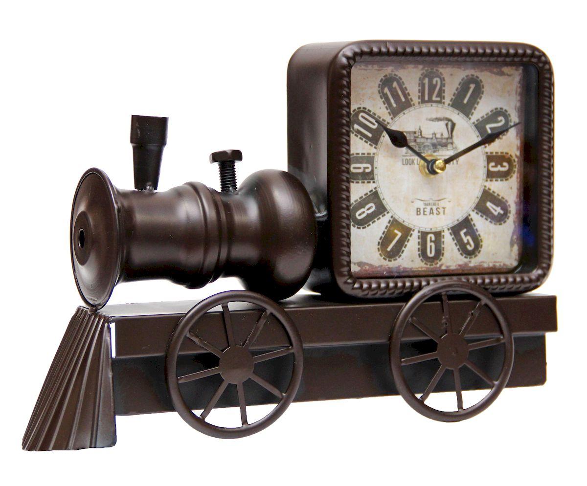 Часы настольные Magic Home Паровоз, кварцевые, цвет: черный41499Настольные кварцевые часы Magic Home Паровоз изготовлены из металла черного цвета, циферблат с покрытием из принтованной бумаги. Настольные часы Magic Home Паровоз прекрасно оформят интерьер дома или рабочий стол в офисе. Часы работают от одной батарейки типа АА мощностью 1,5V (не входит в комплект).